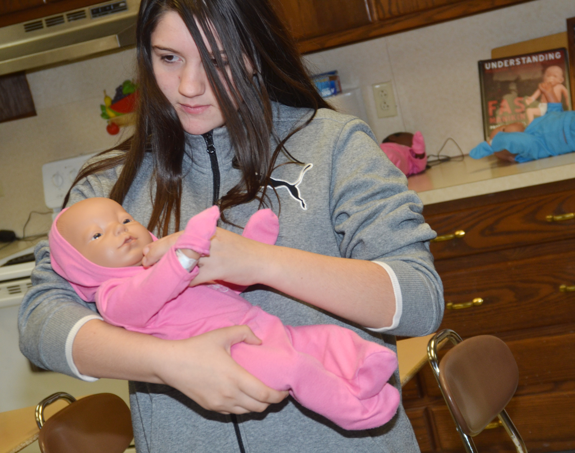 CHS freshman Paula Hoskins makes her Real Care baby laugh.