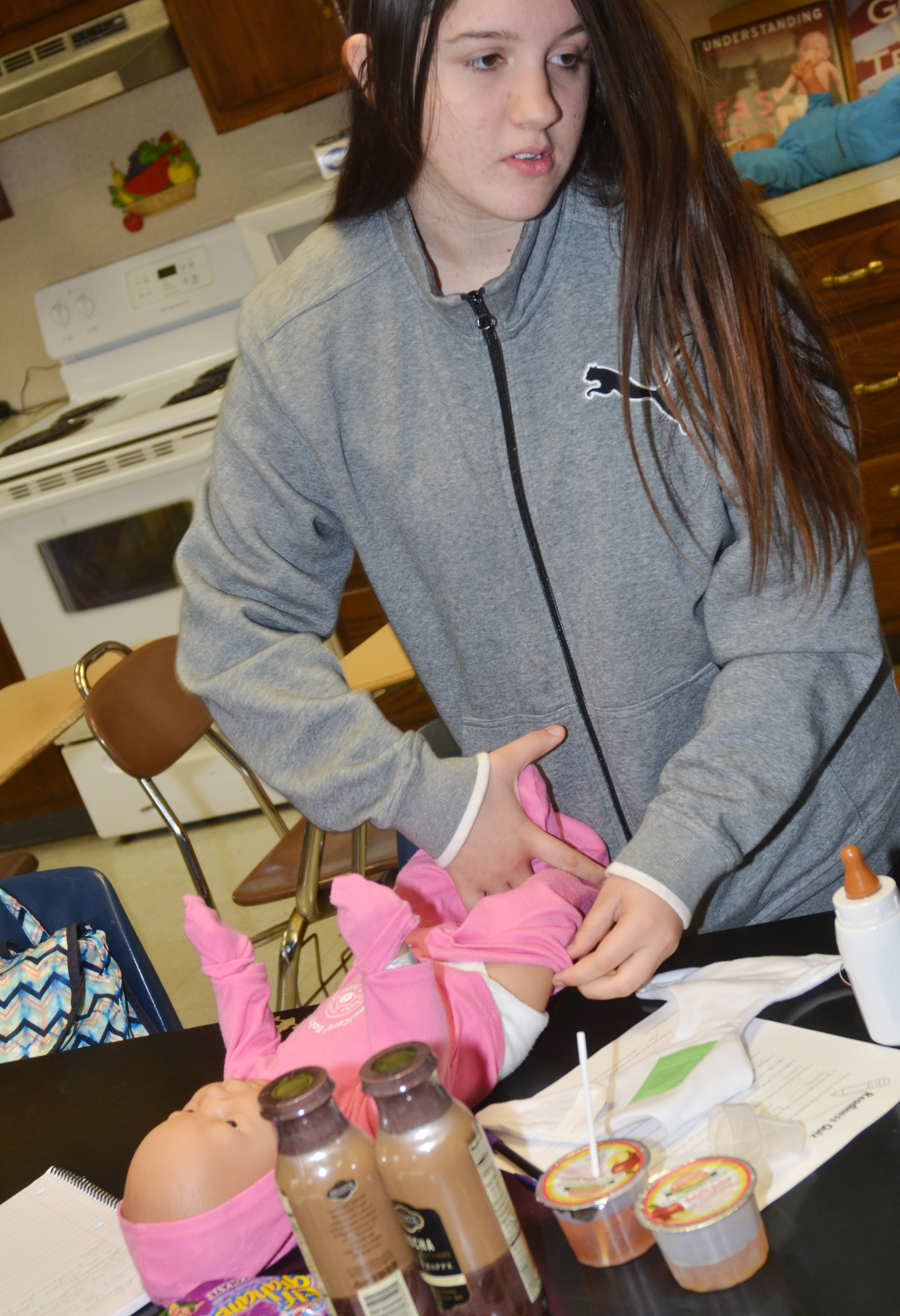 CHS freshman Paula Hoskins changes her Real Care baby.