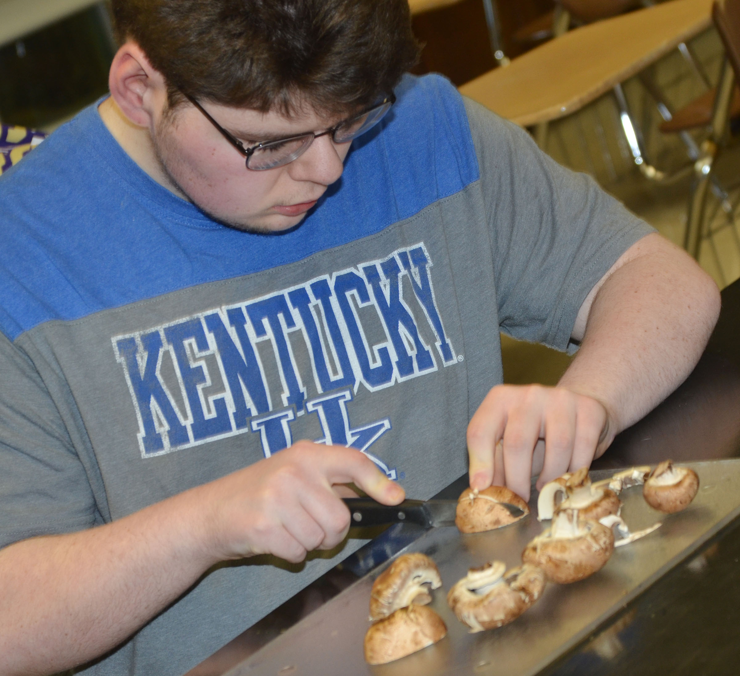 CHS senior Patrick Sapp chops mushrooms.