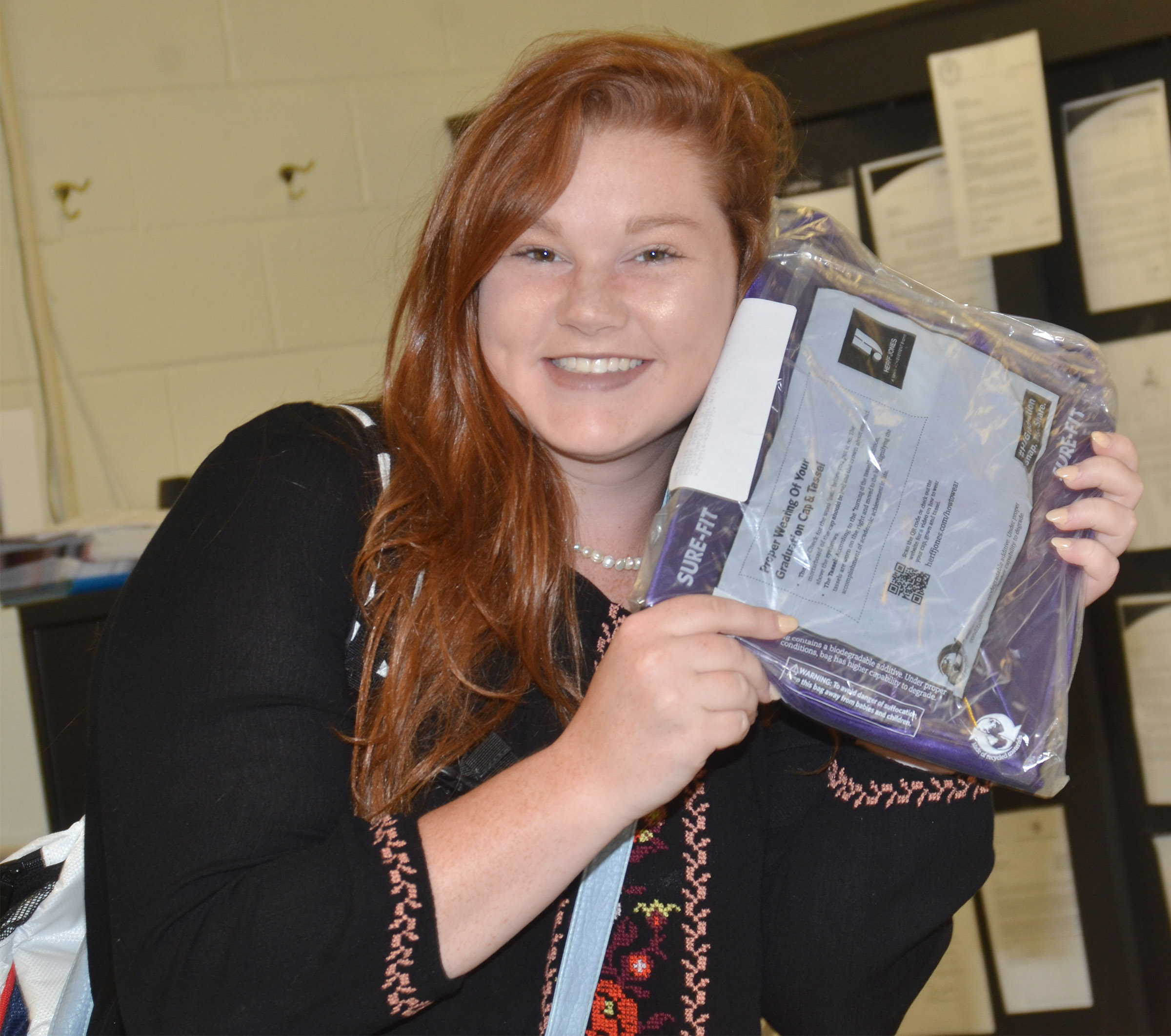 CHS senior Mallory Haley is all smiles as she receives her cap and gown.