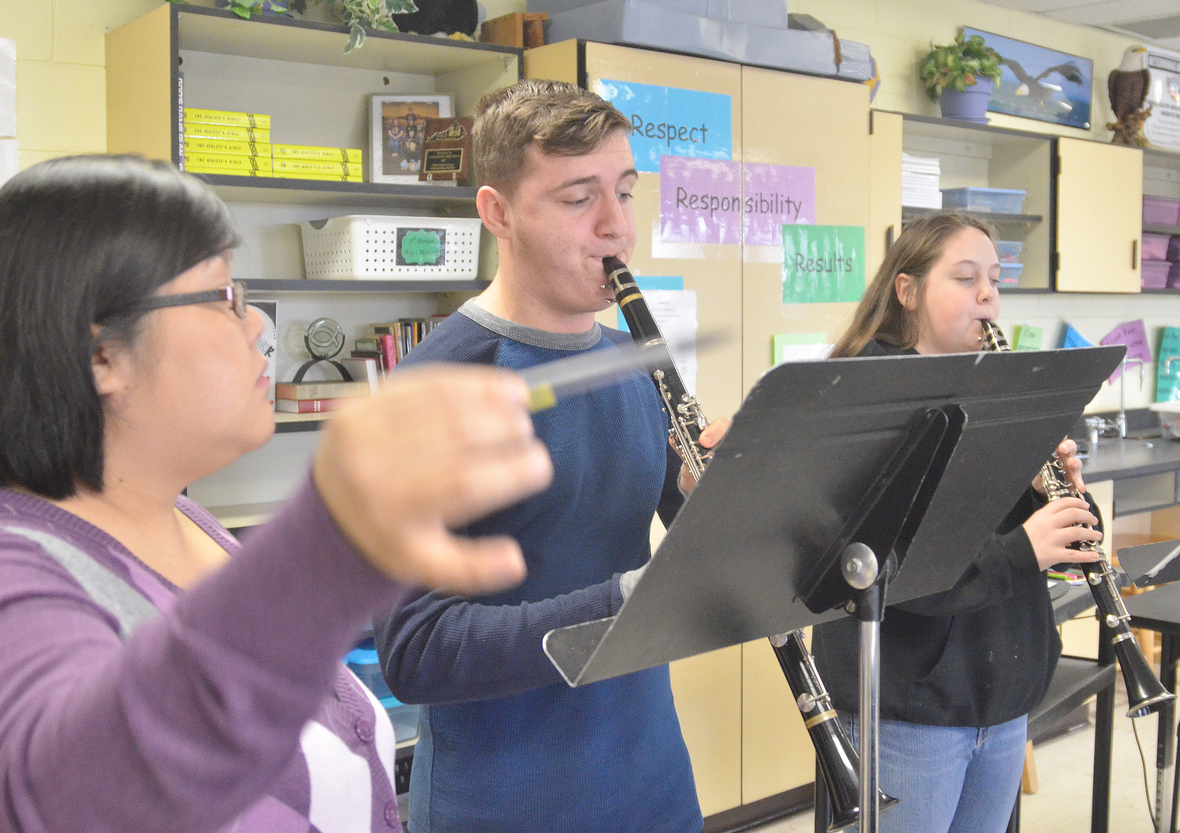 CHS assistant band director Brittany Johnson works with clarinet players junior Austin Fitzgerald, center, and sophomore Ruby Hatfield.
