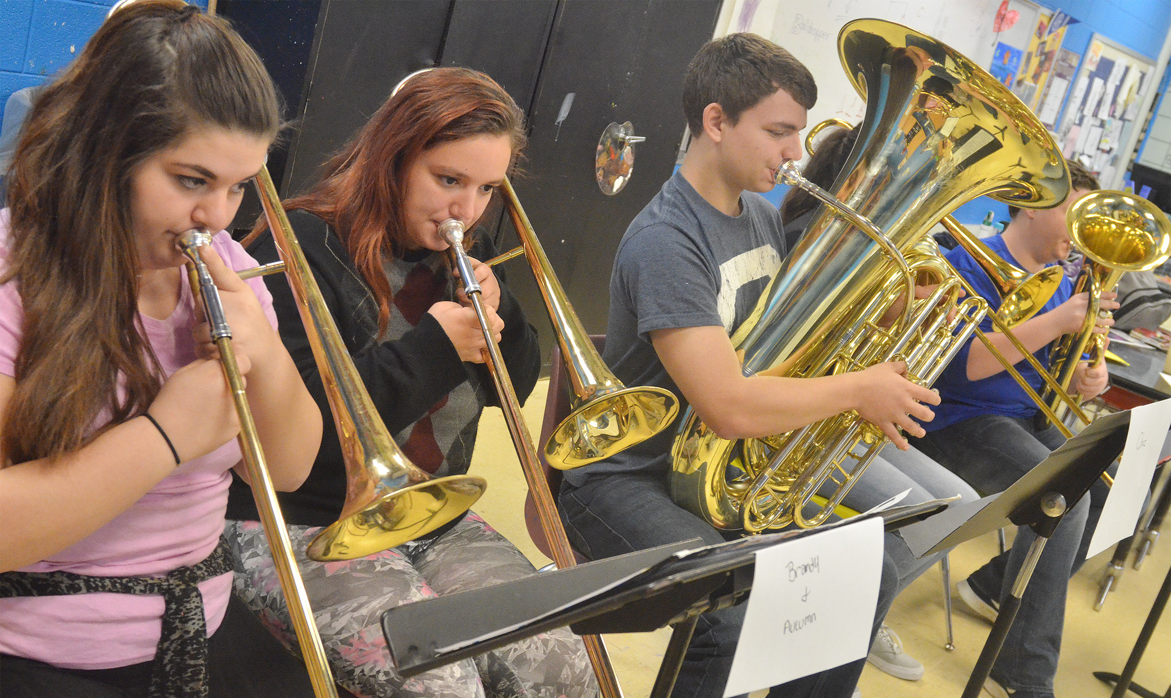 From left, CHS freshmen Brandy Miller and Autumn Babbs and junior Chaz Babbs practice with their band mates.