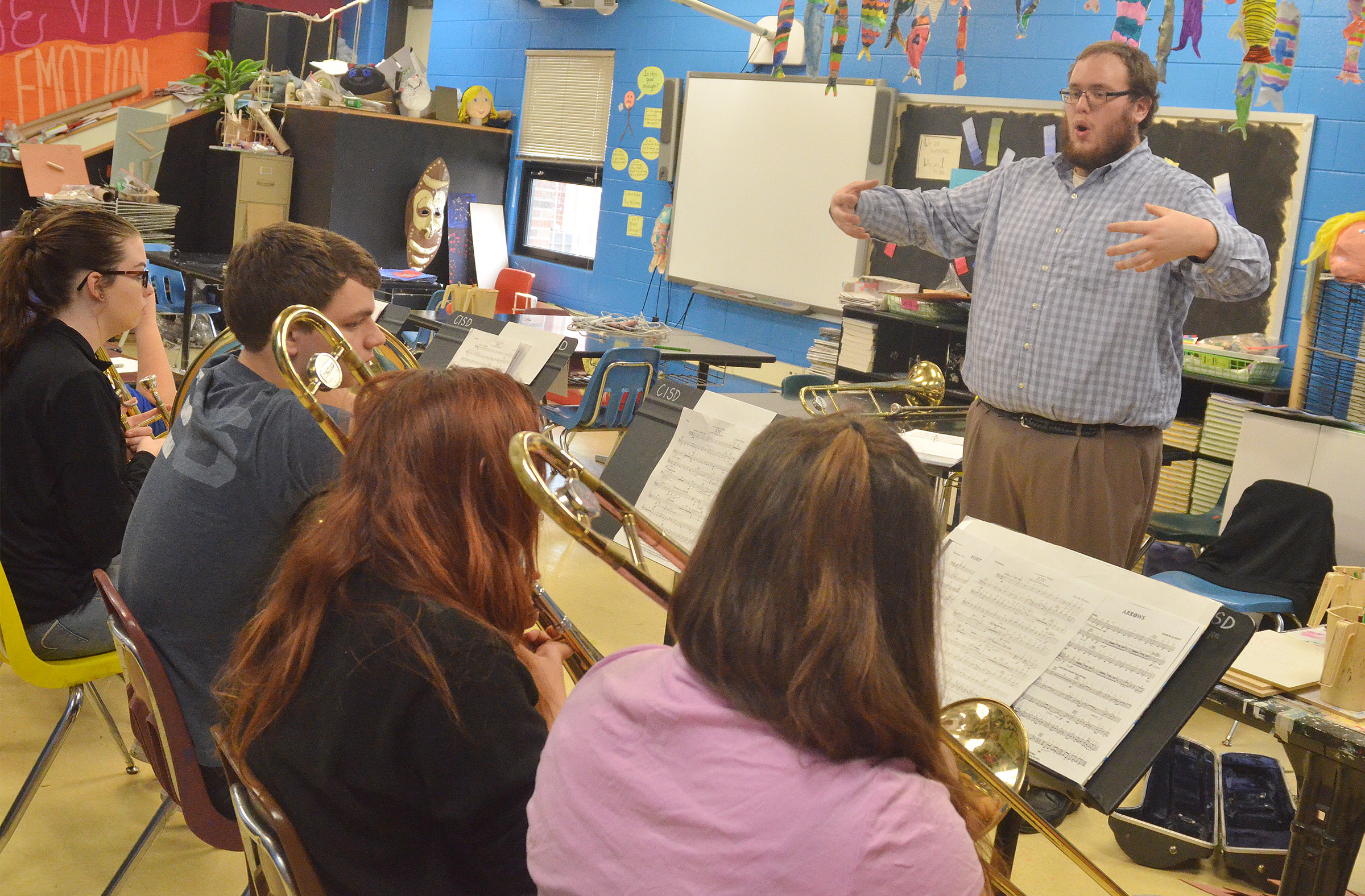 Campbellsville University music student Jeff Cloyd leads CHS brass players during a rehearsal.