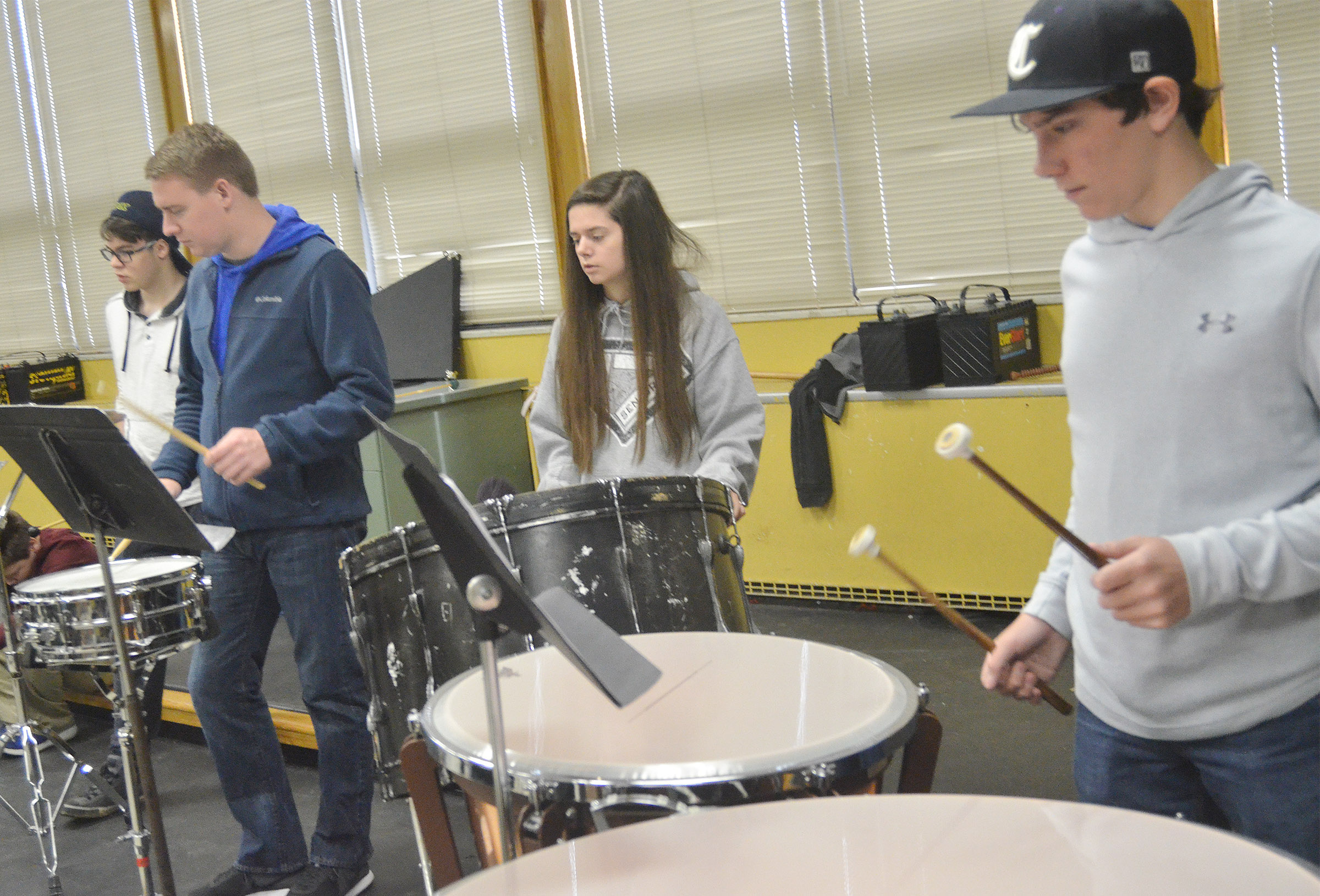 Lindsey Wilson College music student Taylor Cook works with CHS percussion players, from left, sophomore Kyler Rakes, senior Shauna Jones and Campbellsville Middle School seventh-grader Peyton Dabney.