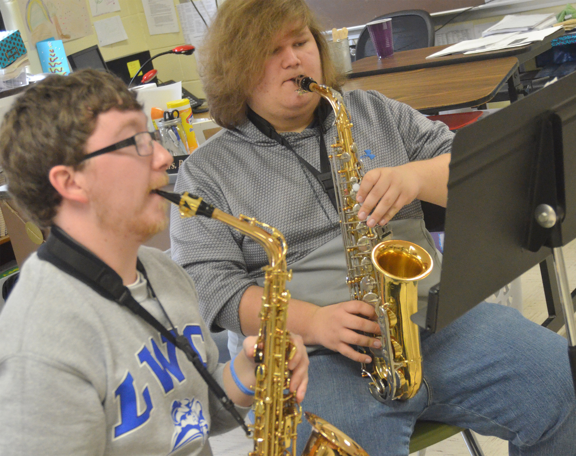CHS sophomore Randy Harris plays saxophone with Lindsey Wilson College student Jordan Humphress.