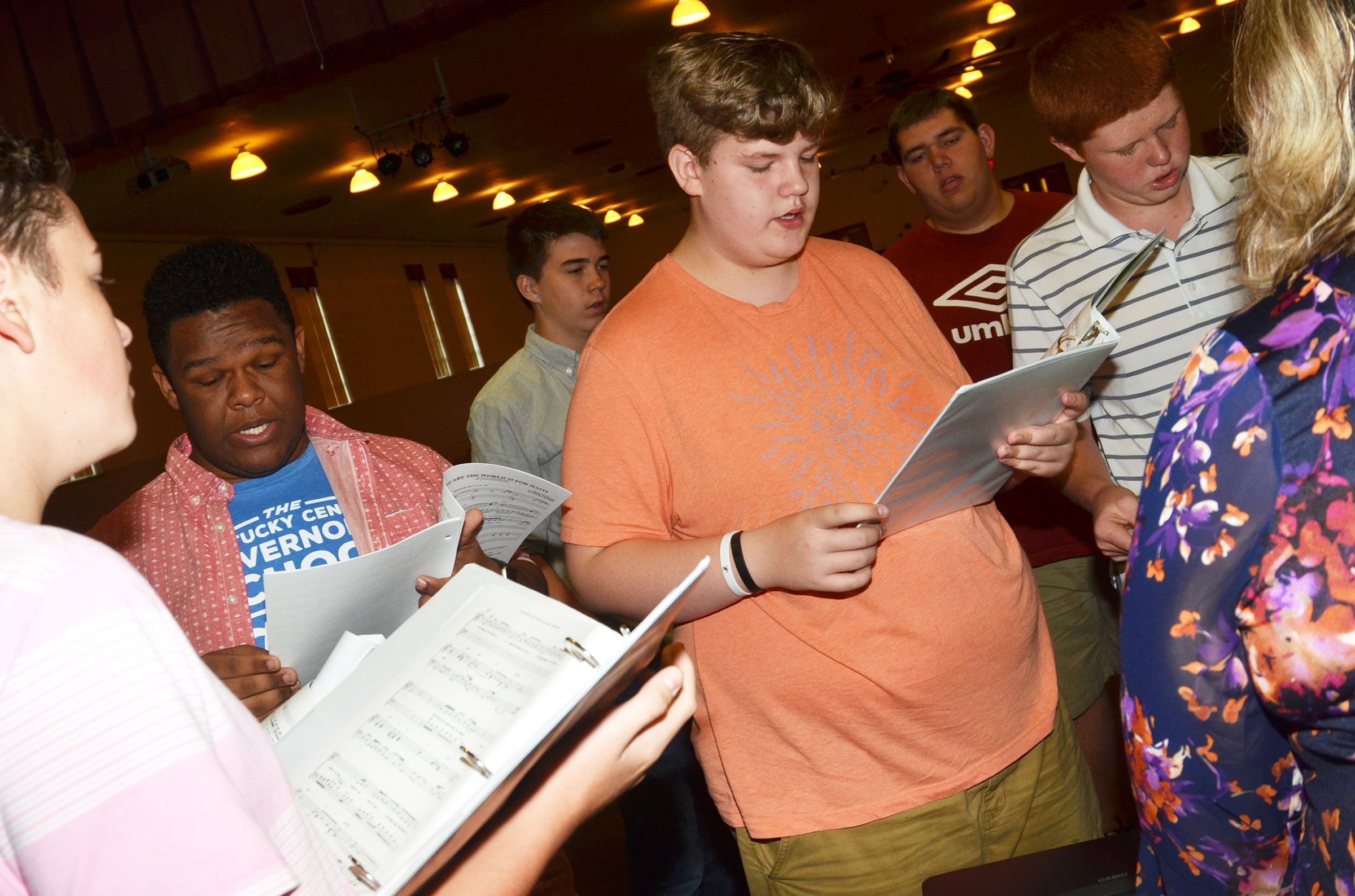 "CHS show choir members, from left, sophomore Gavin Johnson, junior Jeremiah Jackson, sophomore Cole Kidwell, freshman Noah Mardis, senior Ryan Wiedewitsch and freshman Colin Harris sing ""Man in the Mirror"" with choir director Cyndi Chadwick."