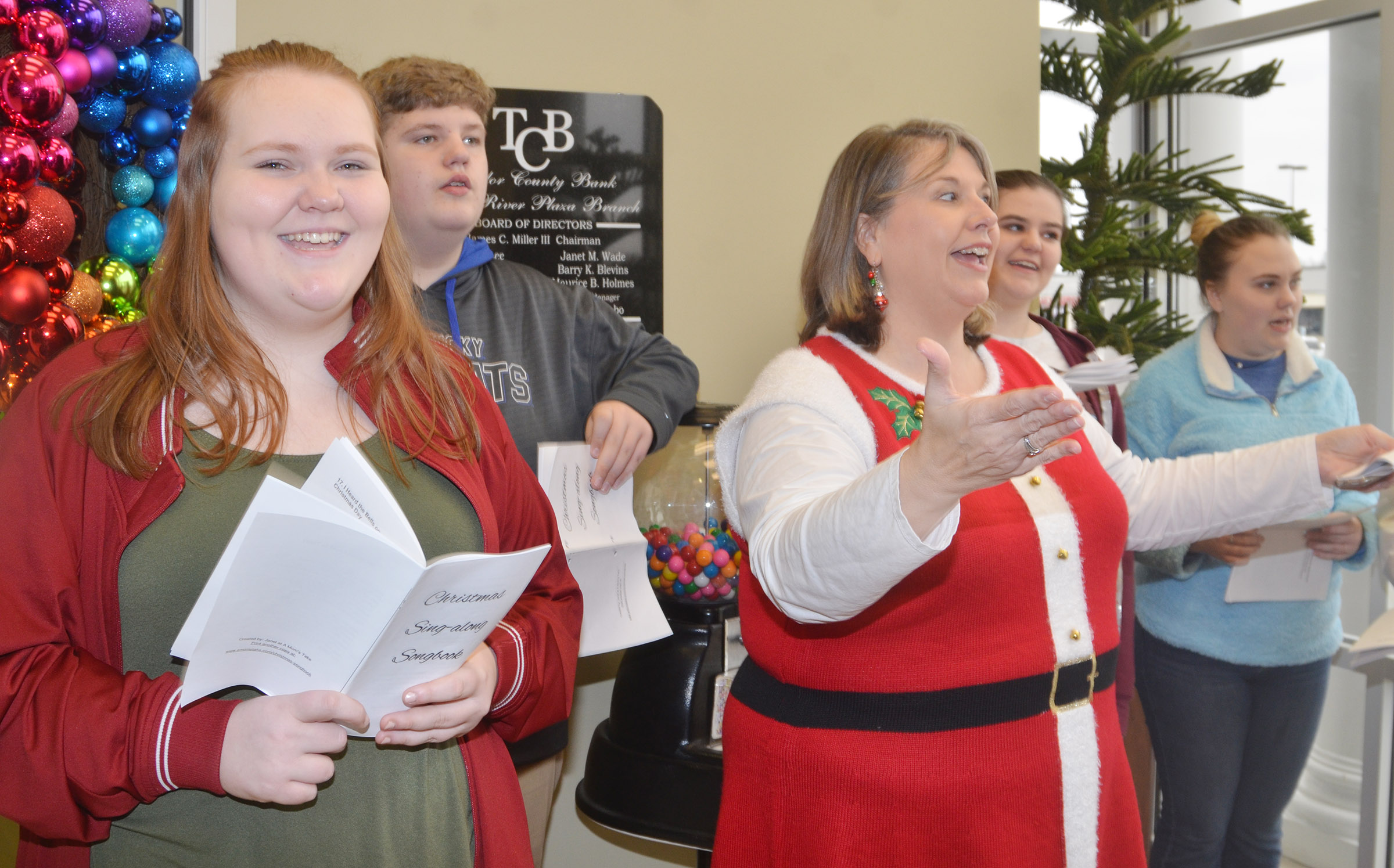 CHS choir members sing Christmas carols at Taylor County Bank. From left, front, are freshman Trinity Lobb and music teacher Cyndi Chadwick. Back, freshman Noah Mardis and seniors Vivian Brown and Haley Fitch.