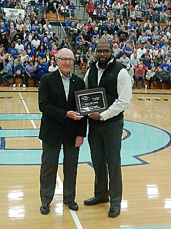 Chuck Vaughn, former Campbellsville Independent Schools superintendent, was recently inducted into the 5th Region Athletic Director's Hall of Fame and was honored at the 5th region boys' basketball championship game on Tuesday, March 7. He is pictured with Campbellsville High School football and boys' basketball assistant coach Will Griffin.