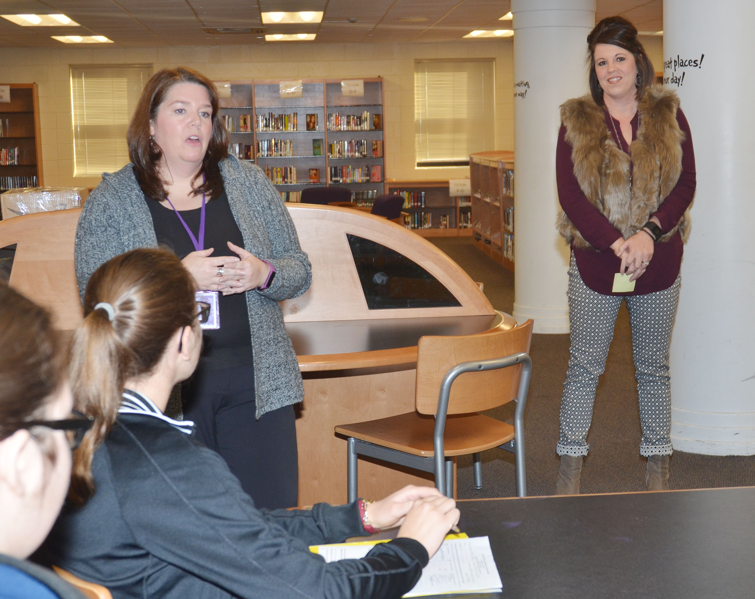 CMS Guidance Counselor Beth Wiedewitsch, at left, and Principal Elisha Rhodes talk to CU education students.