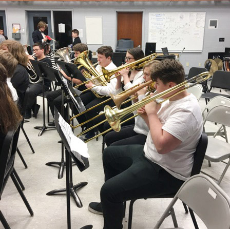 Campbellsville Middle School seventh-grader Austin Jeffries and his bandmates warm up before they perform.