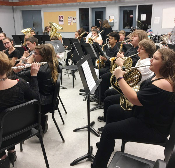 CHS freshmen Abie Angel and her bandmates warm up before they perform.