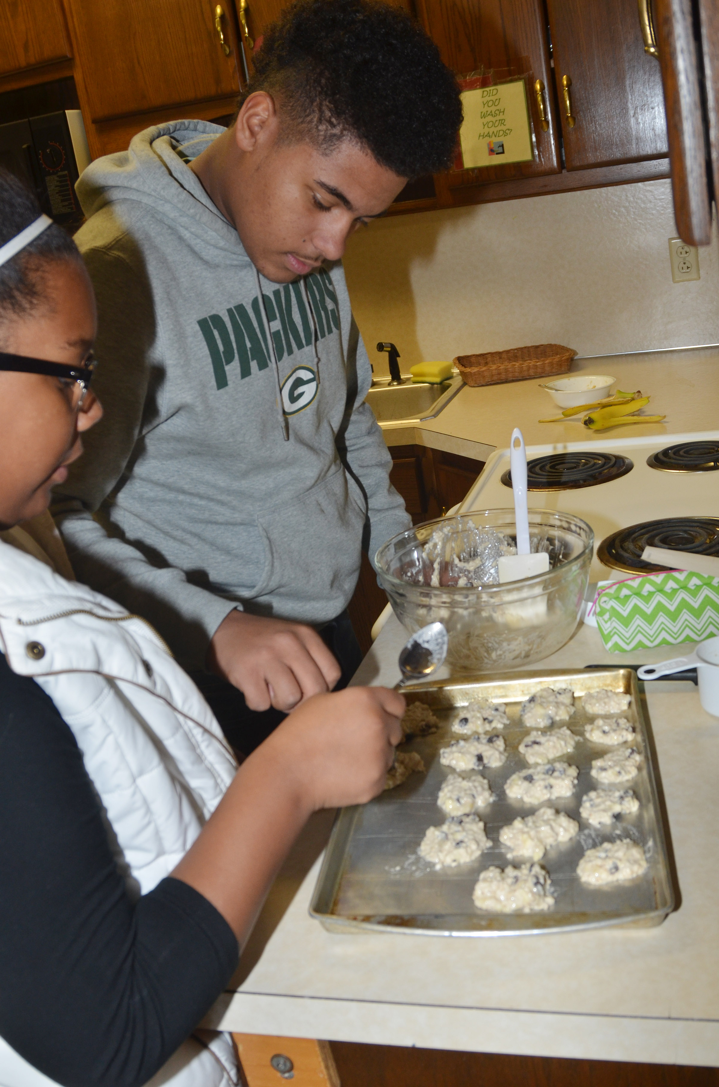 CHS freshmen Zaria Cowan and Braden Paige scoop their chocolate chip yogurt cookies.