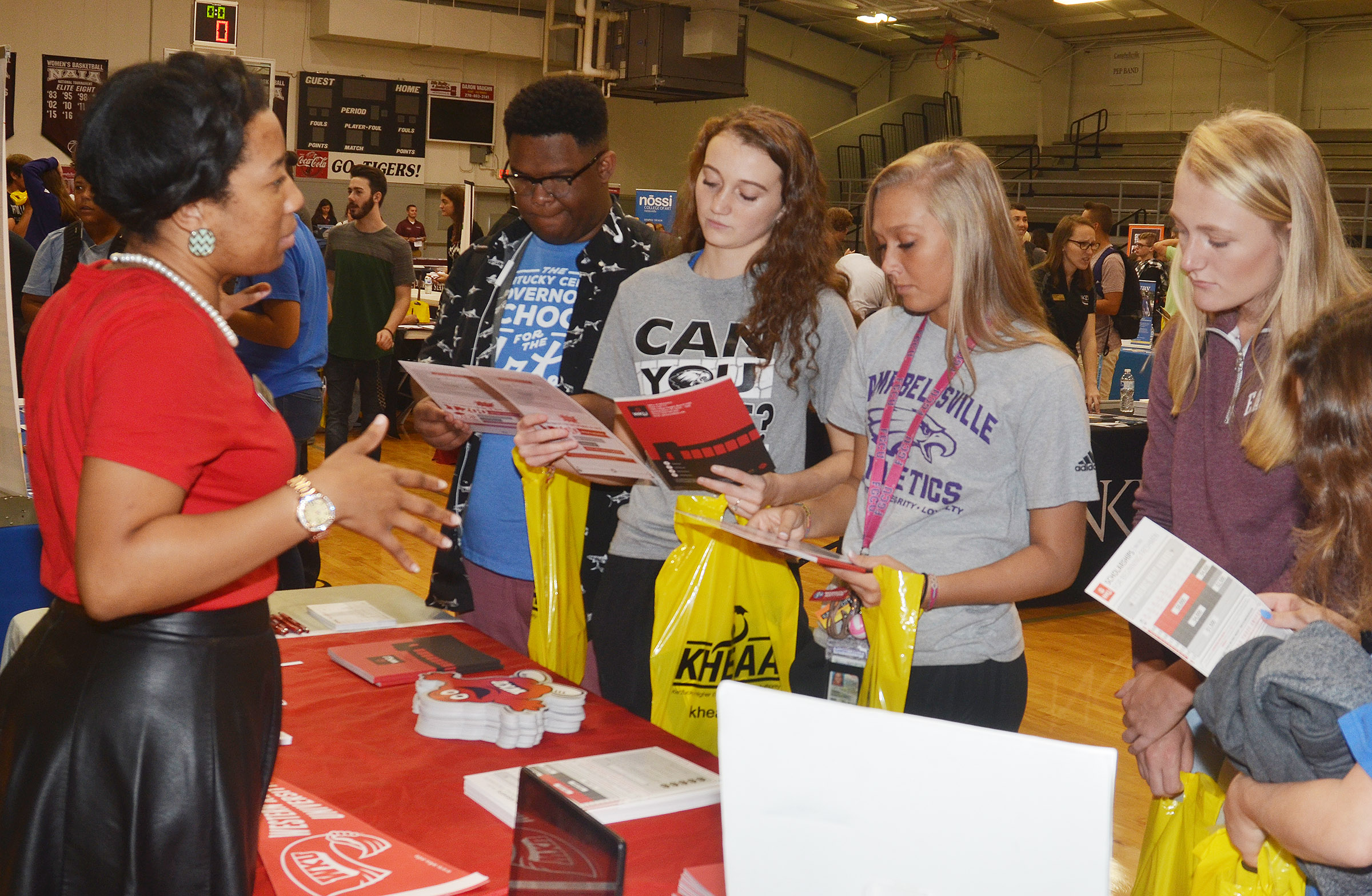 CHS juniors, from left, Jeremiah Jackson, Salena Ritchie, Tatem Wiseman and Abbie Dicken learn about Western Kentucky University.