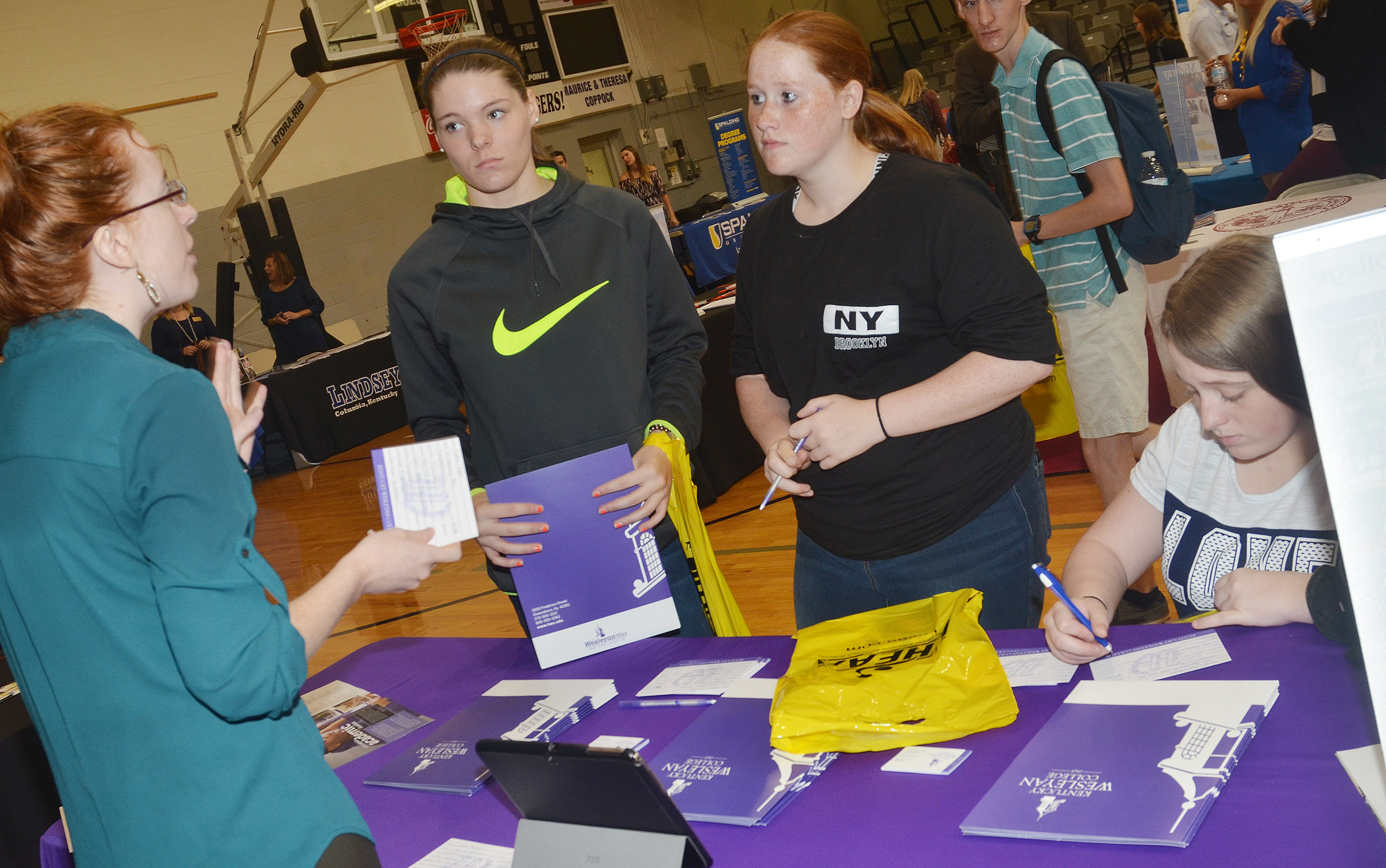 CHS juniors, from left, Cassie Pipes, Gracie Miller and Hailey Armstrong learn about Kentucky Wesleyan College.