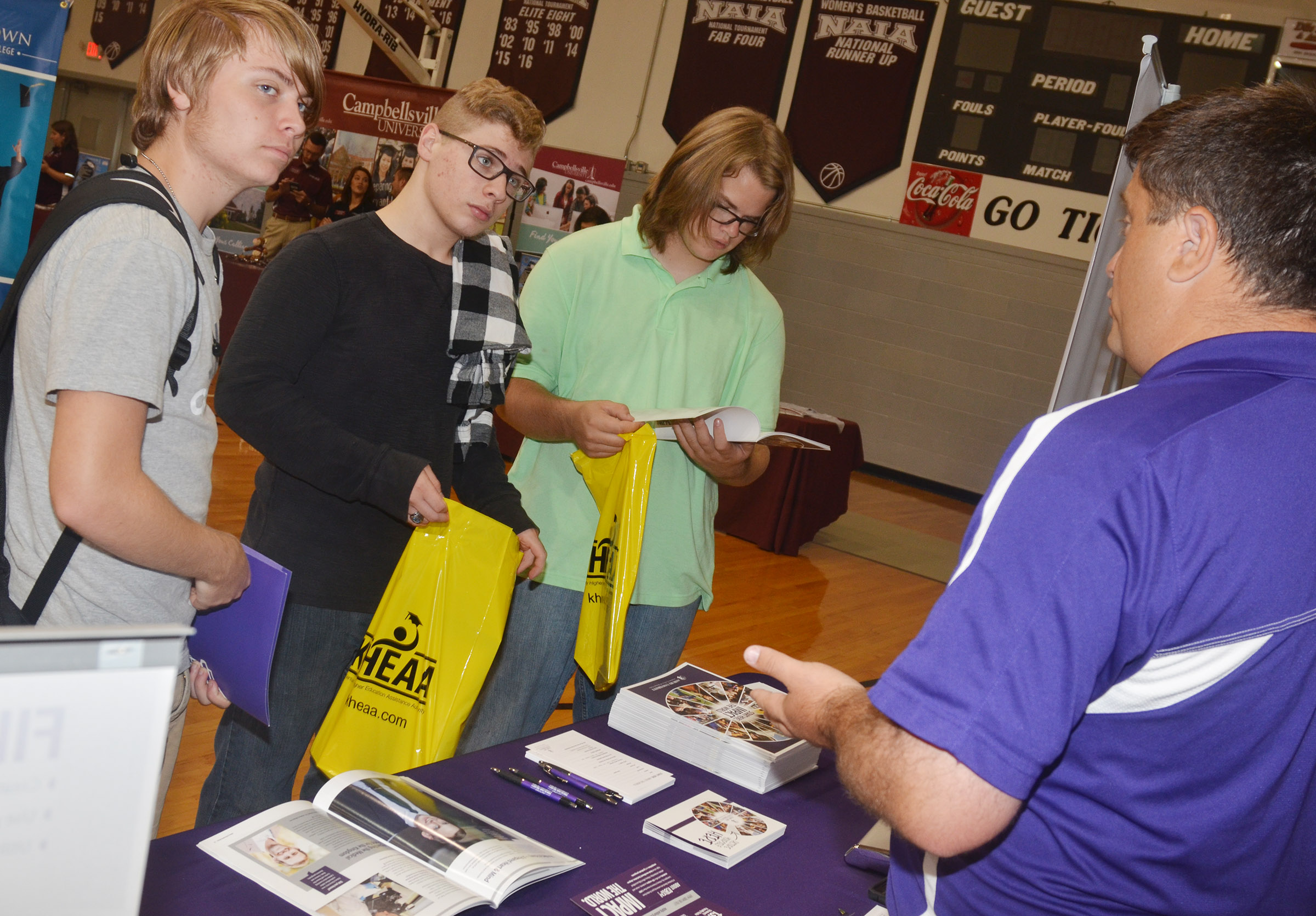 CHS seniors Nate Mills and Nick Lefever, at left, and junior John Netherland learn about Asbury University.