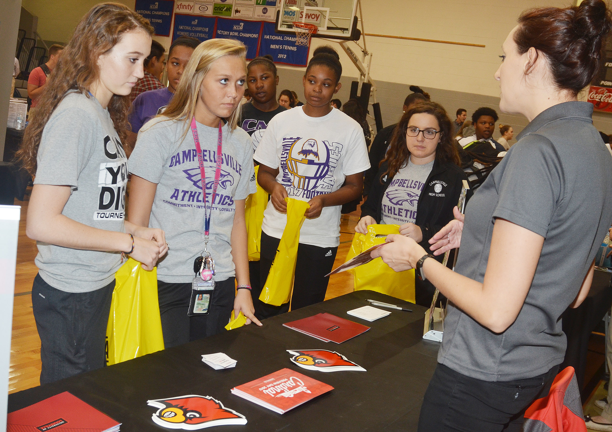 From left, CHS juniors Salena Ritchie and Tatem Wiseman and seniors Vonnea Smith and Caitlin Bright learn about the University of Louisville.