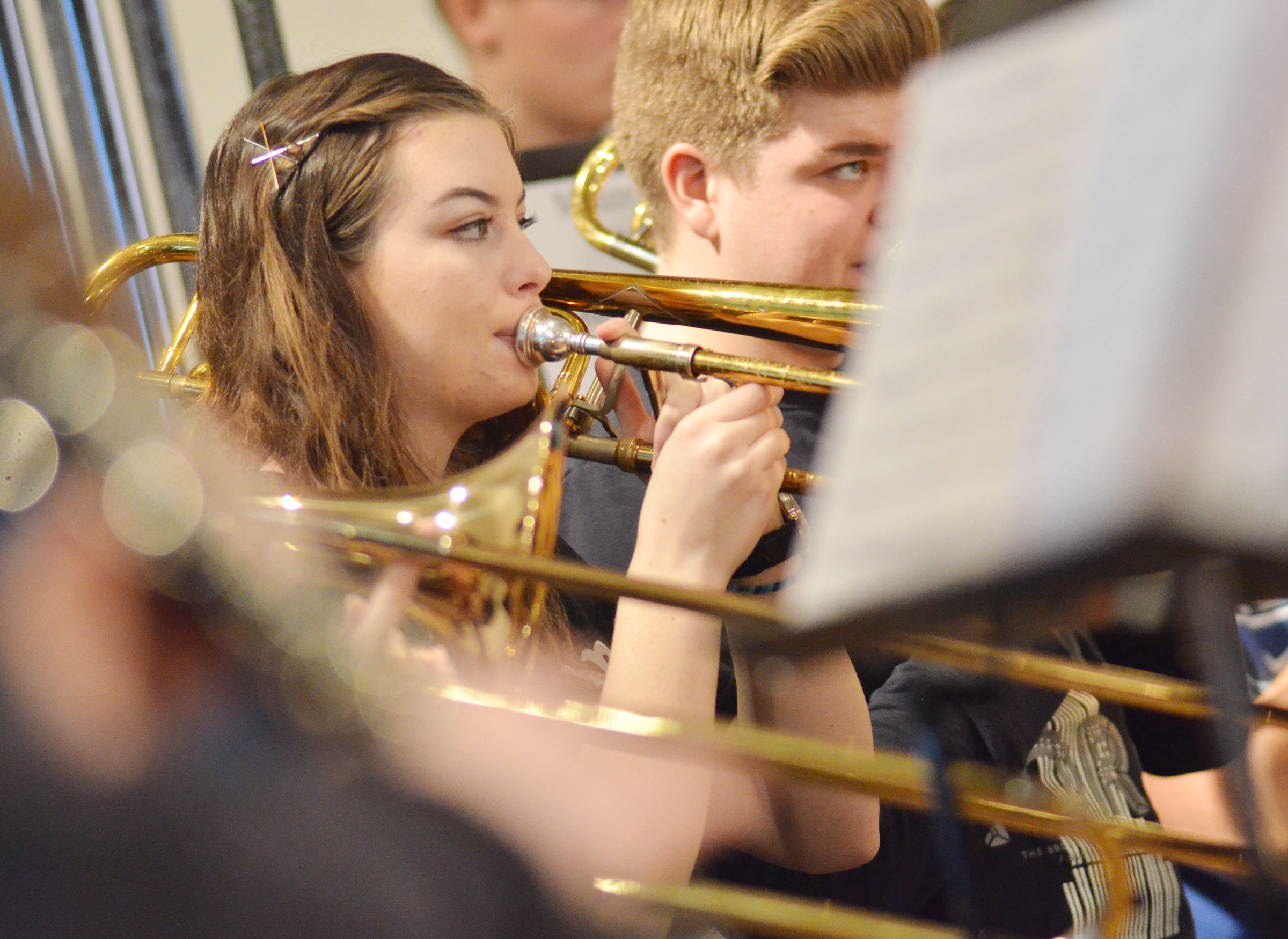 CHS senior Laura Lamb plays trombone during a CU Honors Band rehearsal.