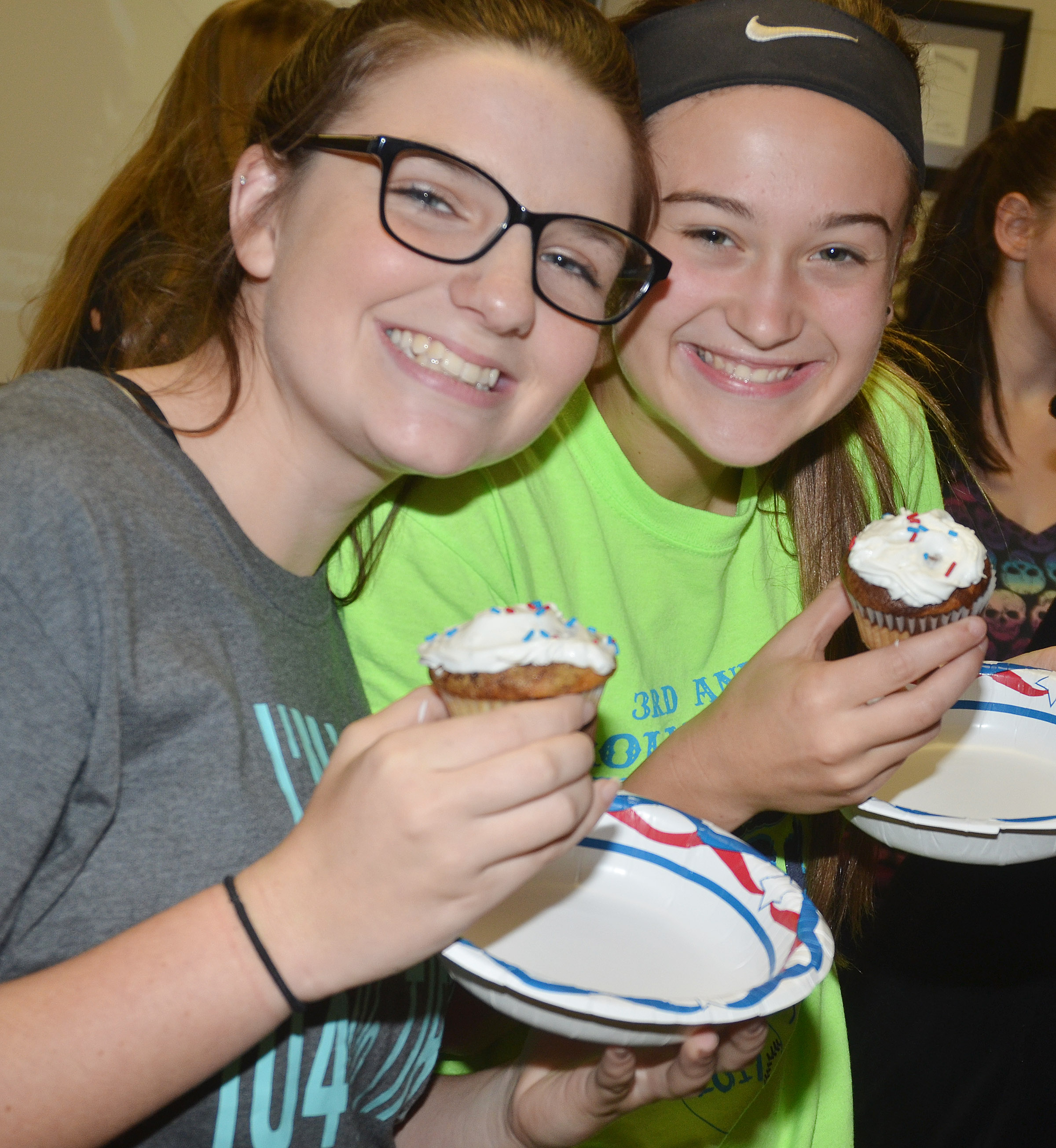 CES sophomores Sydney Wilson, at left, and Bailey Thompson enjoy their marble cake cupcakes at their Constitution Day party.
