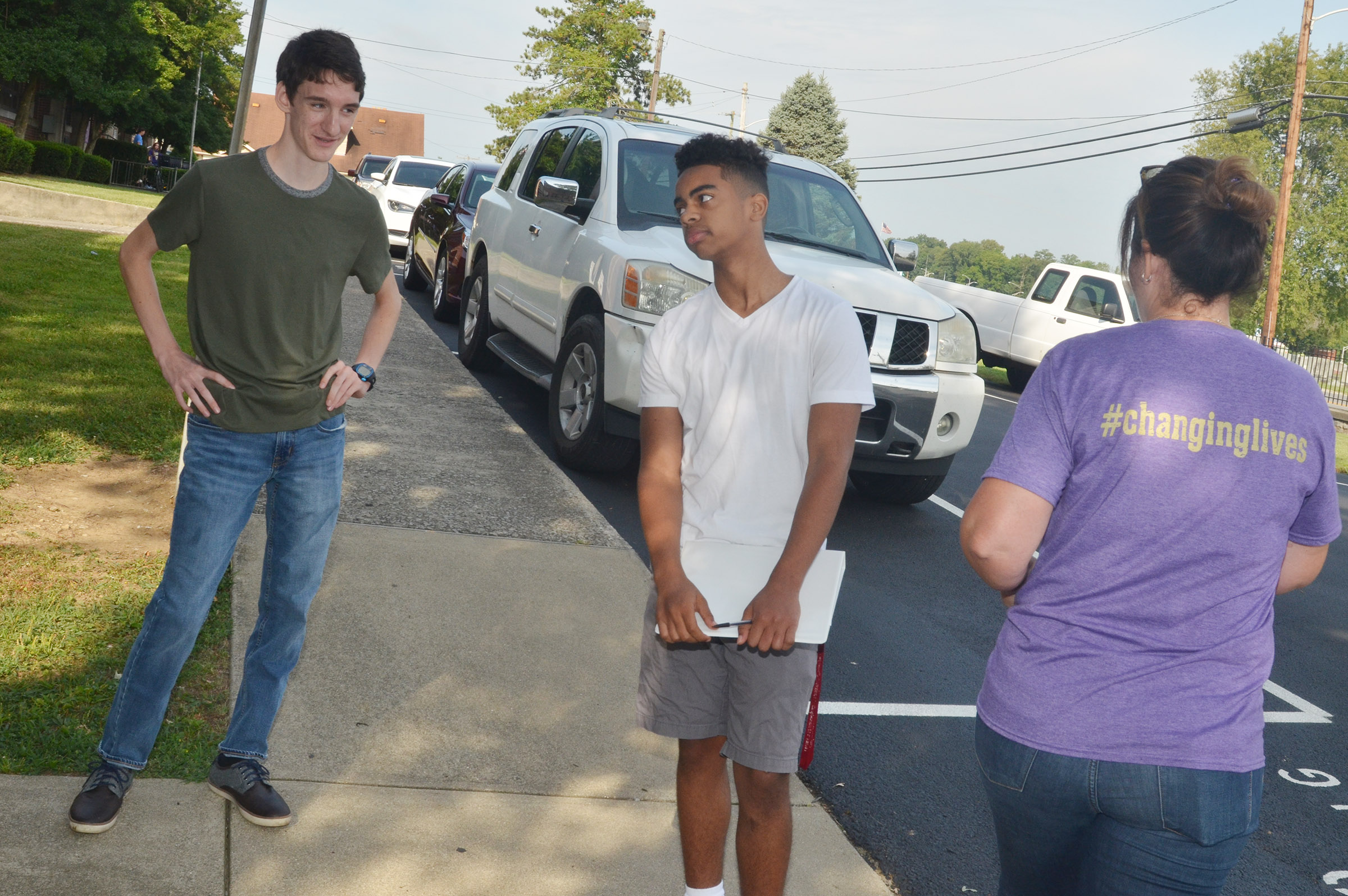 CHS juniors Ian McAninch, at left, and Davon Cecil work together to describe their surroundings as they study the concept of contextualization. Their teacher, Susan Dabney, is at right.