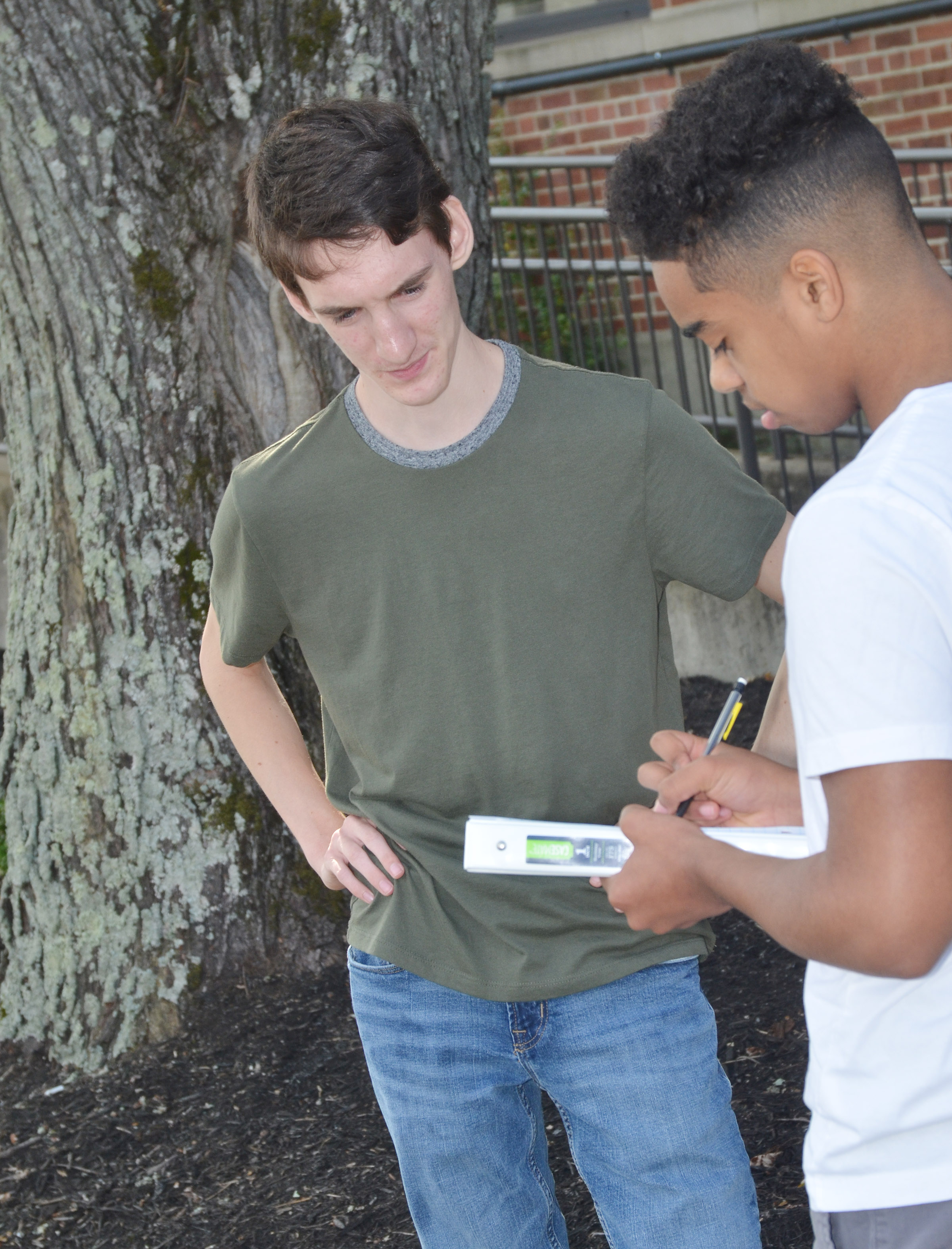 CHS juniors Ian McAninch, at left, and Davon Cecil work together to describe their surroundings as they study the concept of contextualization.