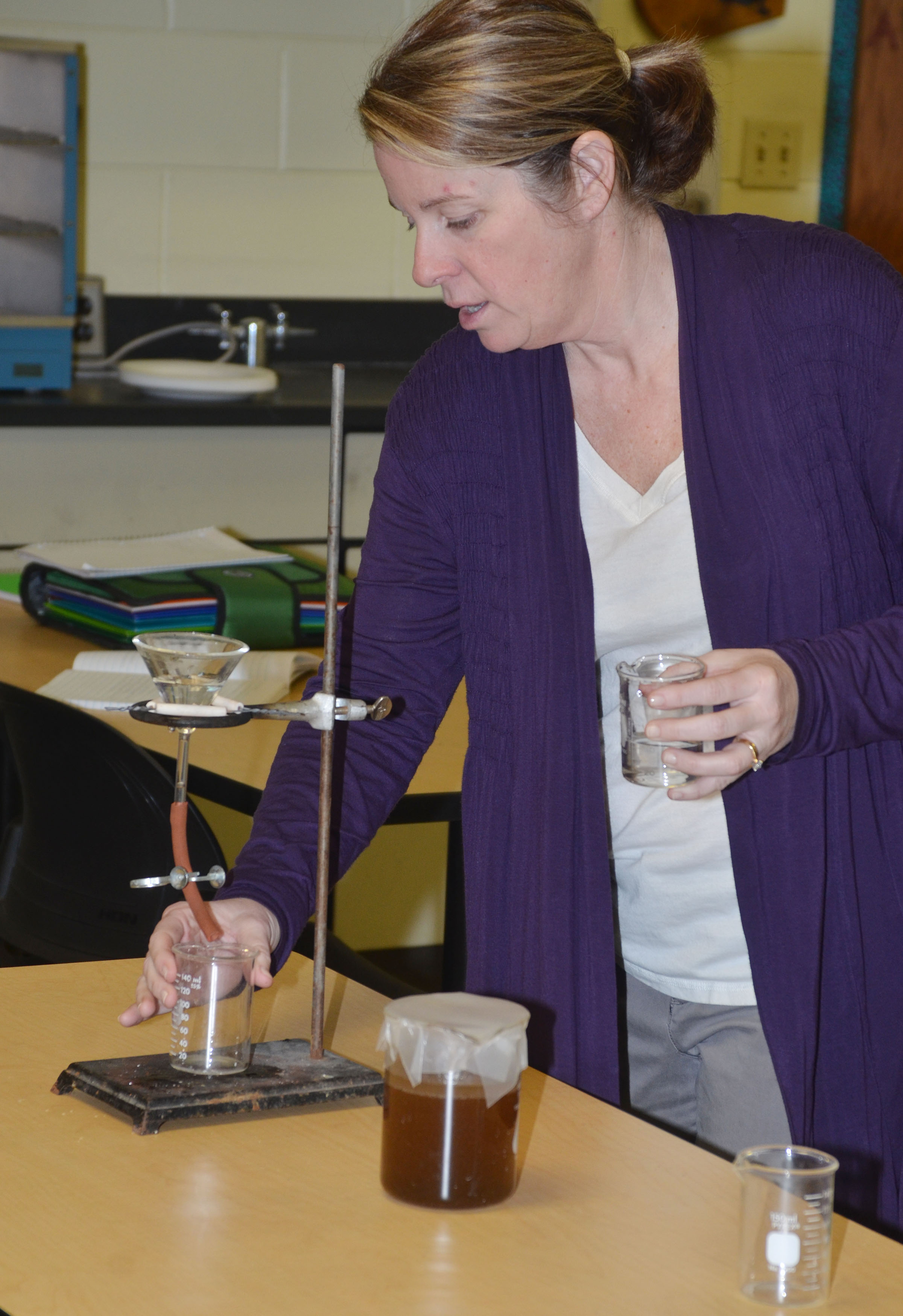 CHS teacher Dee Doss shows students how to separate oil from water.