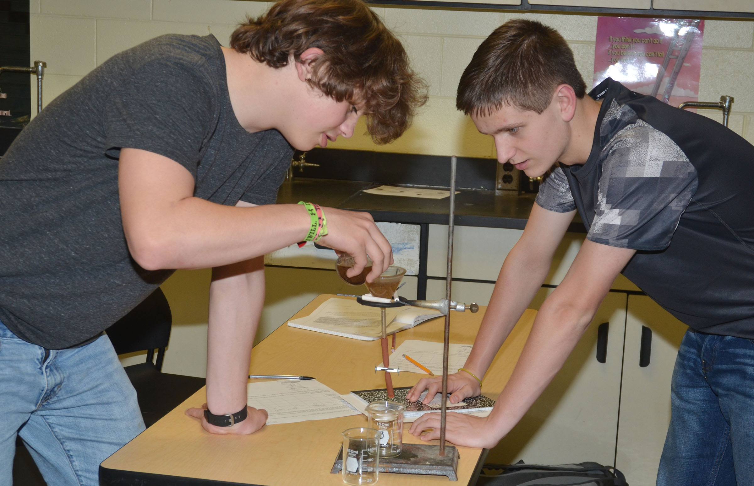 CHS sophomores Treyce Mattingly, at left, and Myles Murrell work to separate the oil from their dirty water.