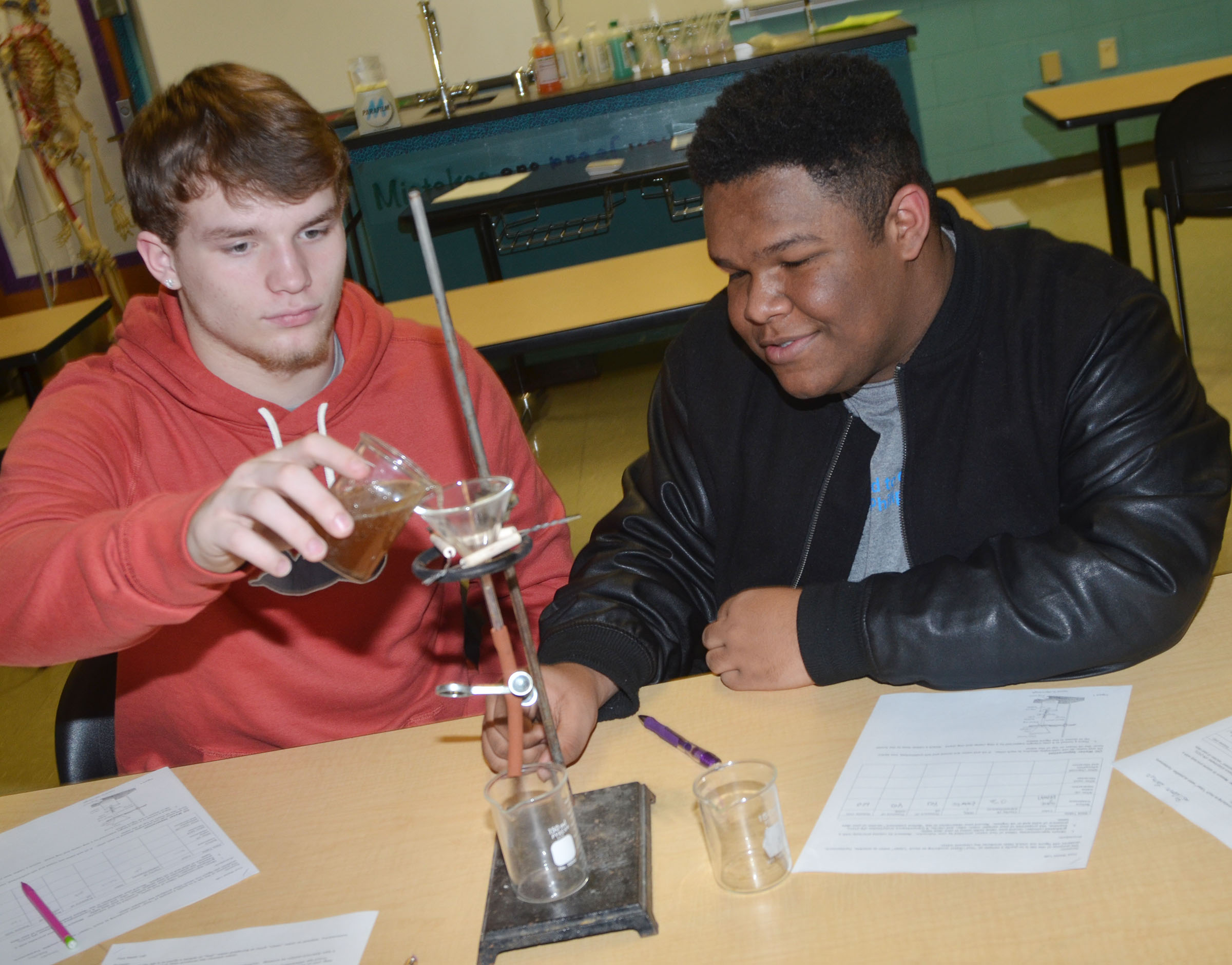 CHS sophomores Dakota Reardon, at left, and Jeremiah Jackson separate the oil from their dirty water.