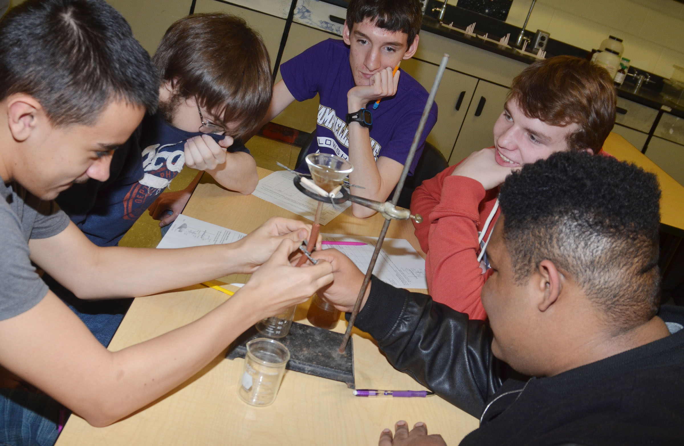 From left, CHS sophomore Glenn Lamer, senior Gabriel Clark and sophomores Ian McAninch, Dakota Reardon and Jeremiah Jackson work to separate the oil from their dirty water.