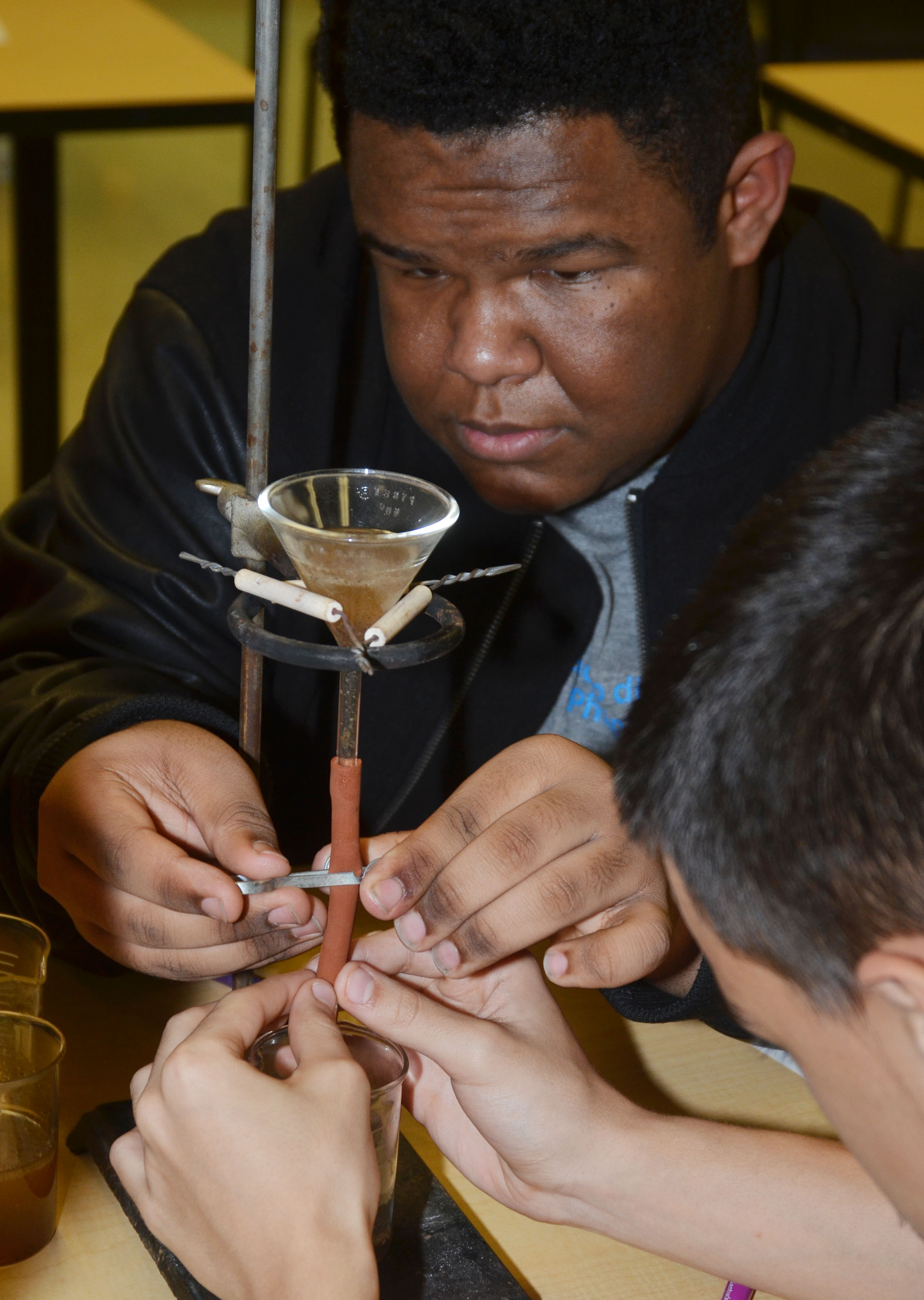 CHS sophomore Jeremiah Jackson and Glenn Lamer, at right, work to separate oil from their dirty water.