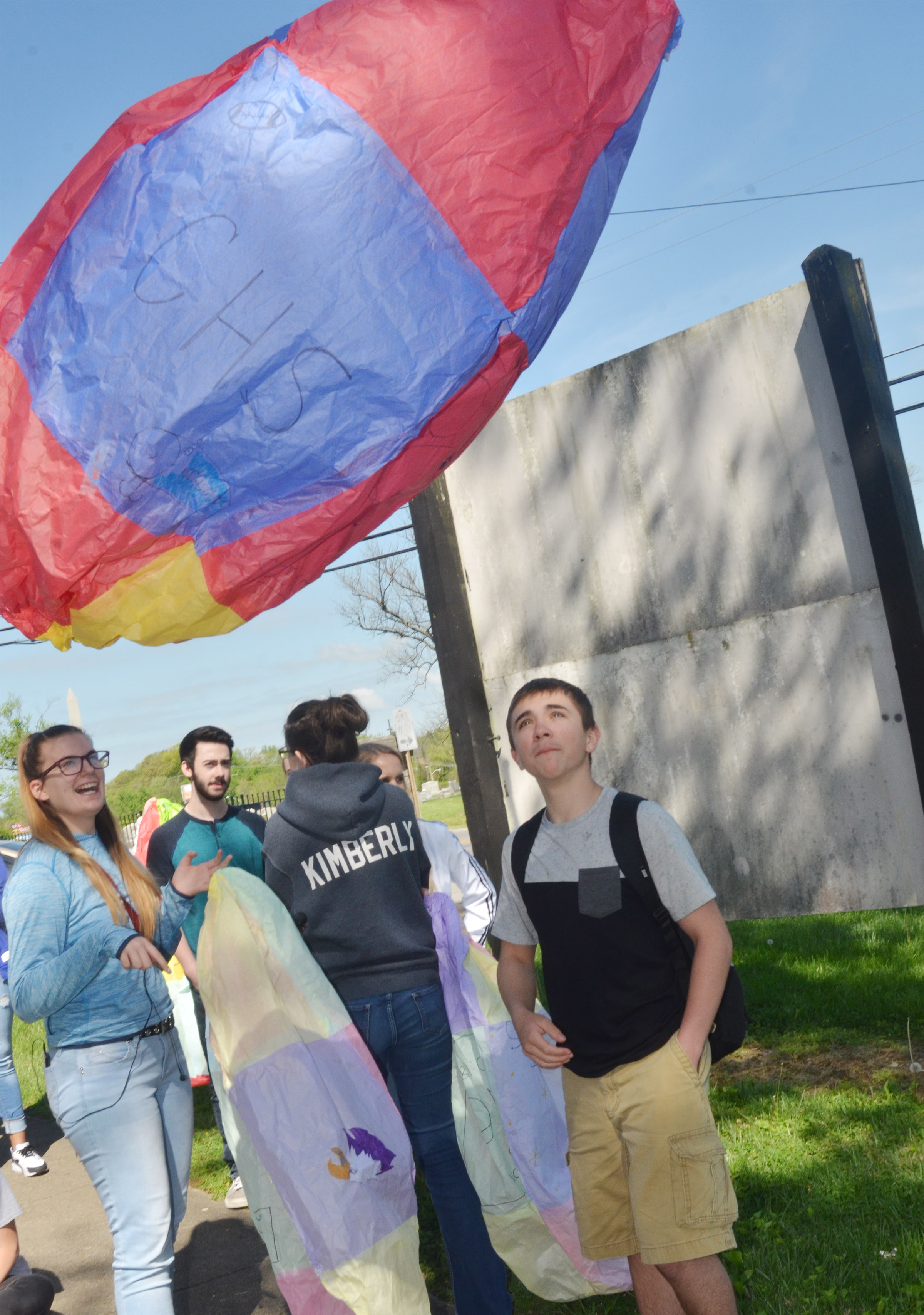 CHS juniors Tiffany Kane, at left, and Austin Carter watch as Carter's balloon flies.