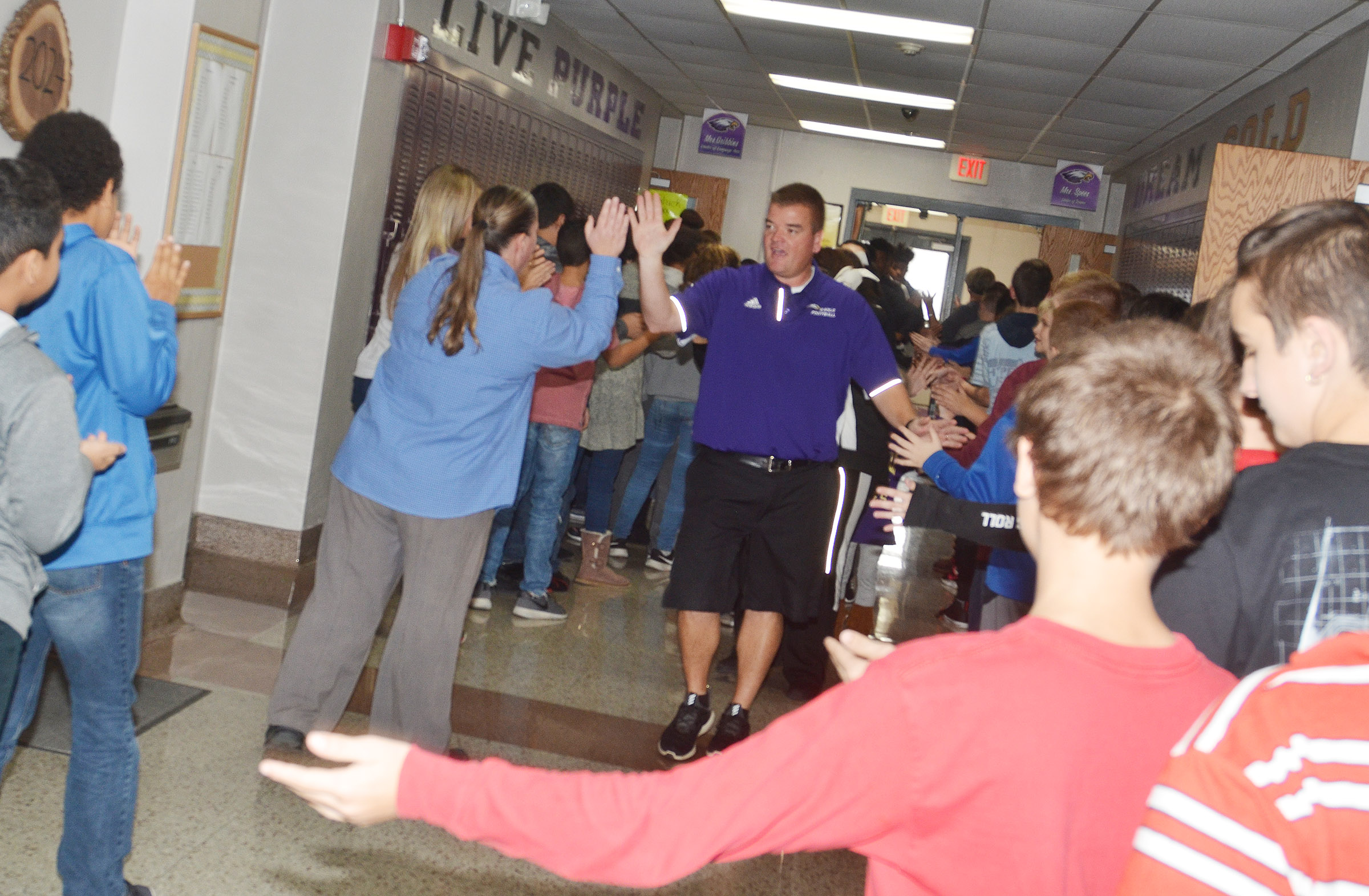 CHS head football coach Dale Estes leads the Eagle Walk through CMS.
