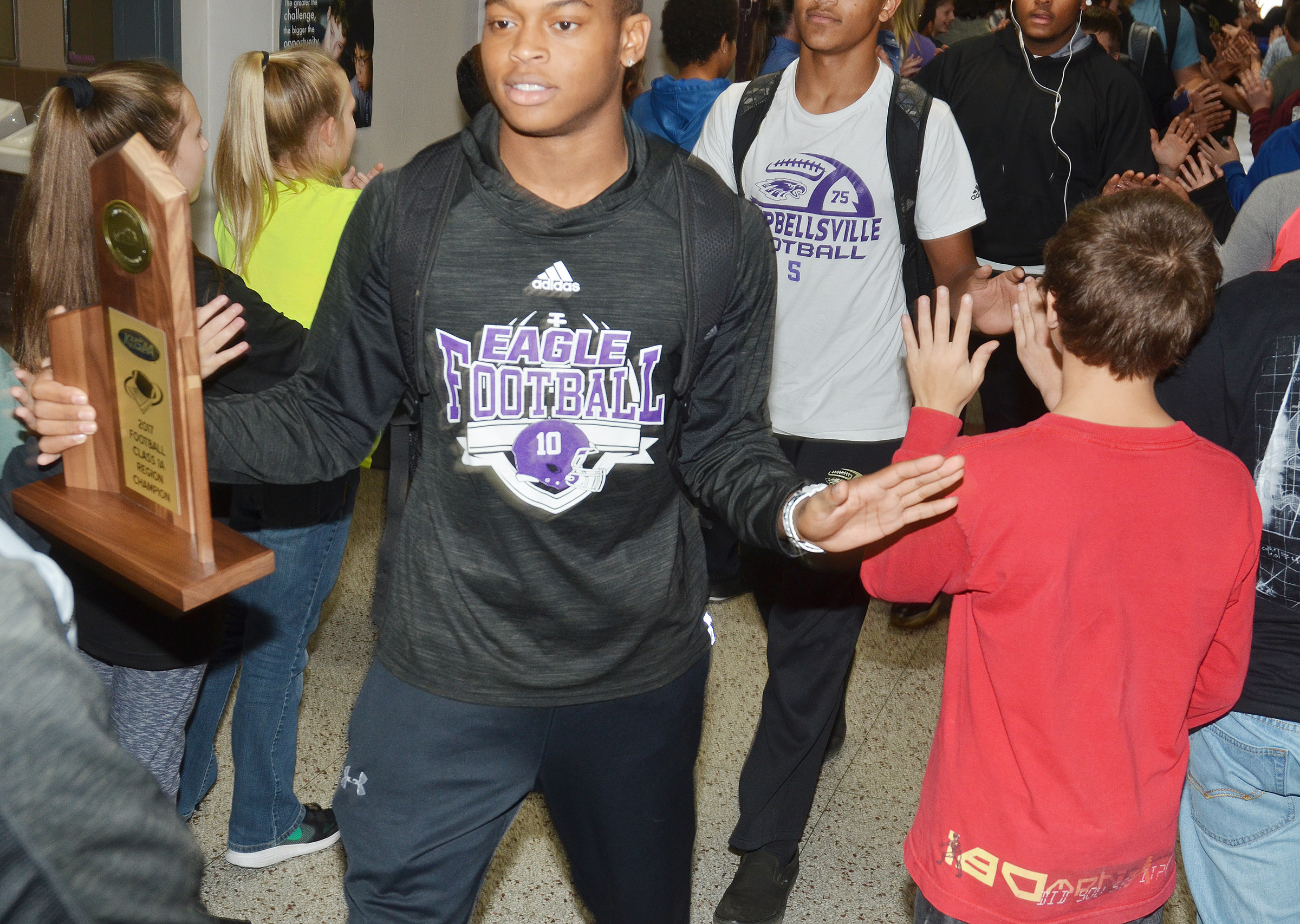 CHS senior Devonte Cubit walks with his teammates through CMS.
