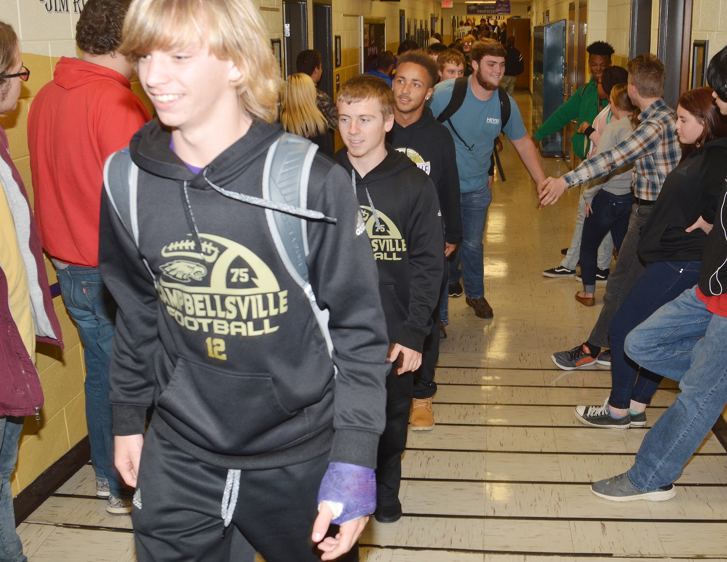 CHS freshman Arren Hash leads his classmates through the CHS hallways.