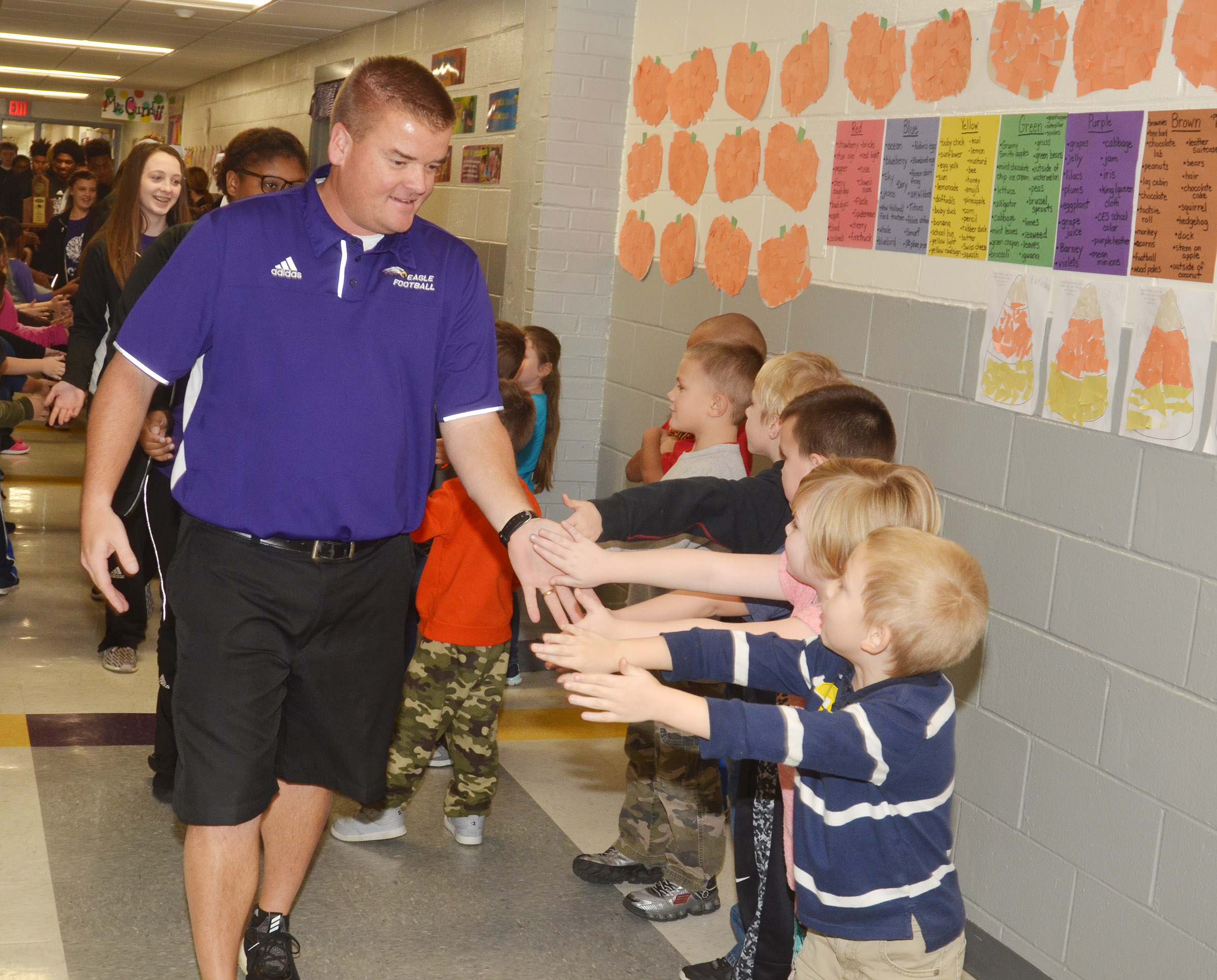 CHS head football coach Dale Estes leads the Eagle Walk through CES.