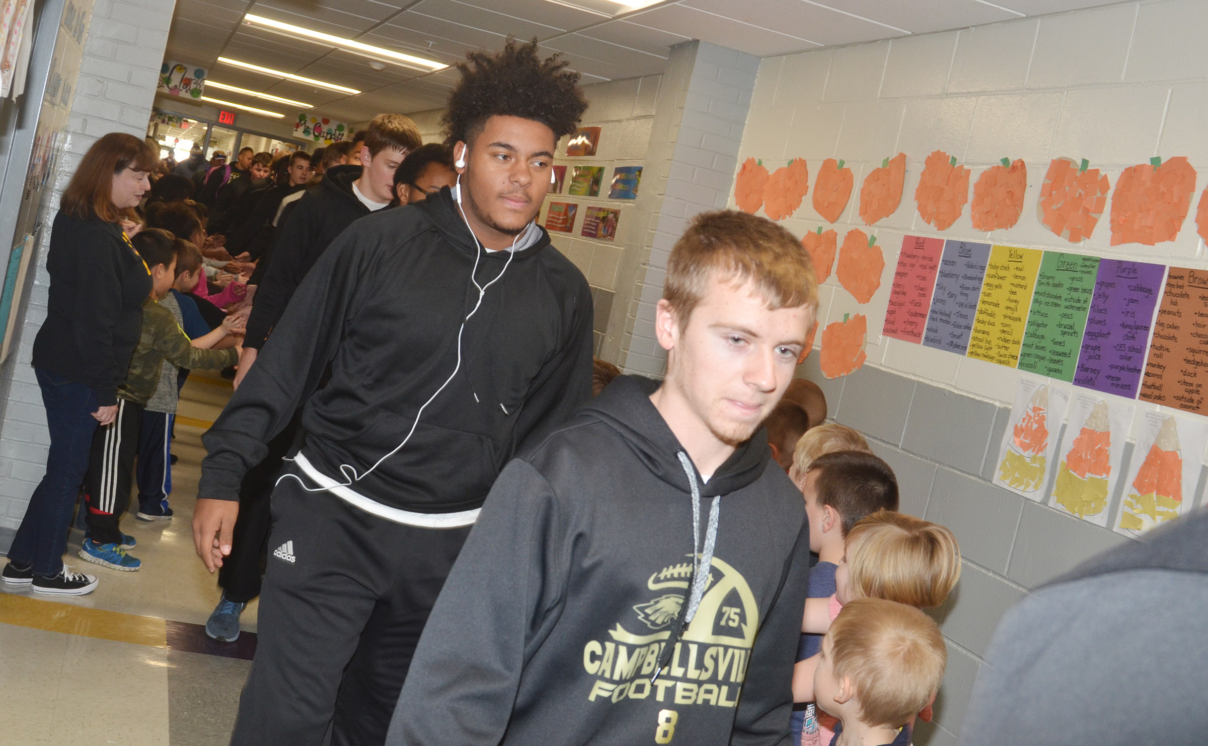 CHS sophomores Braden Paige, at left, and Kelson Griffiths walk through CES.