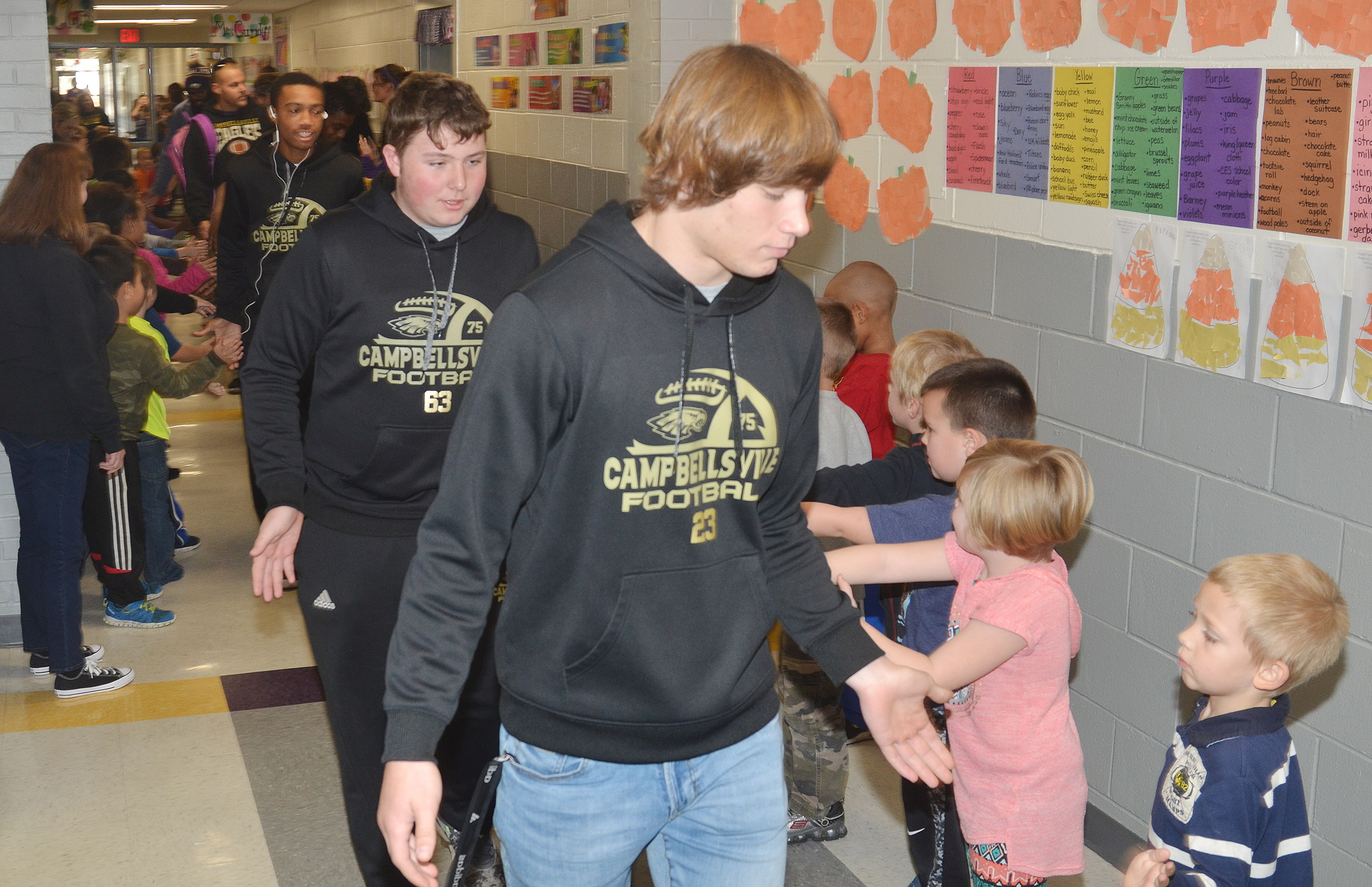 CHS freshman Alex Howard, at left, and junior Tristan Johnson walk through CES.