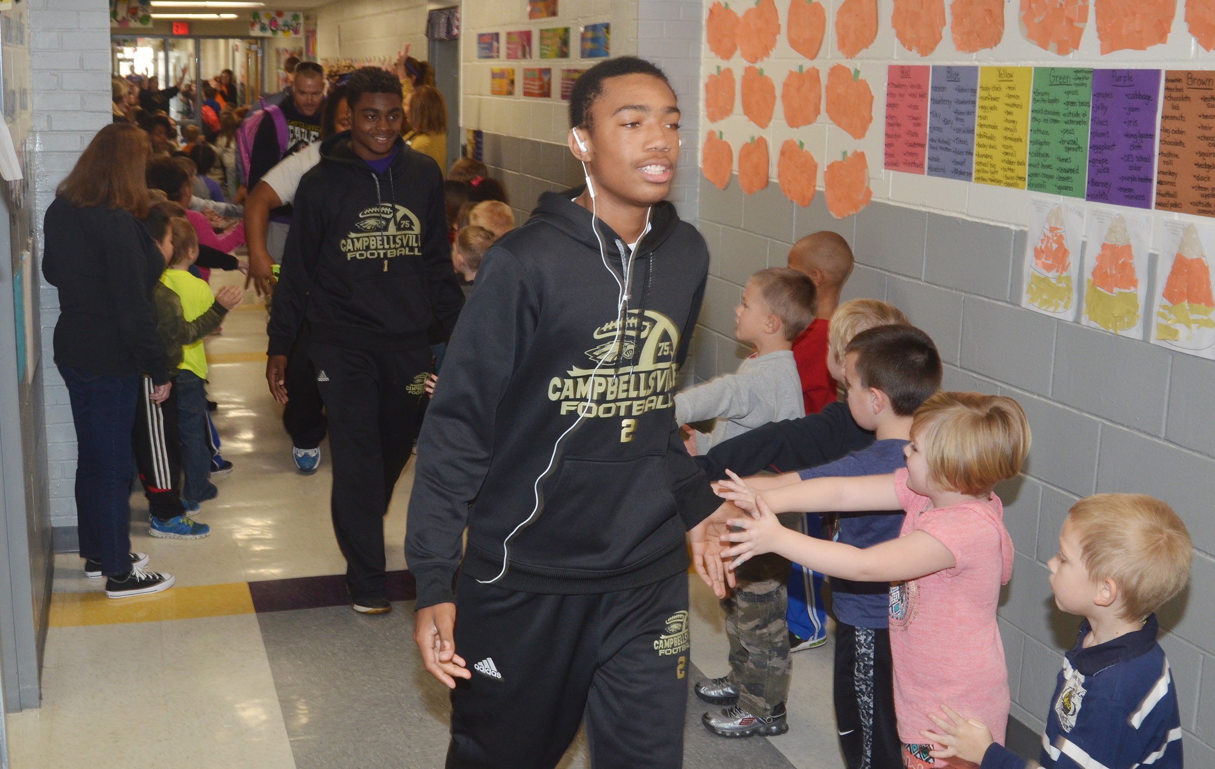 CHS sophomore Lathan Cubit walks with his teammates through CES.