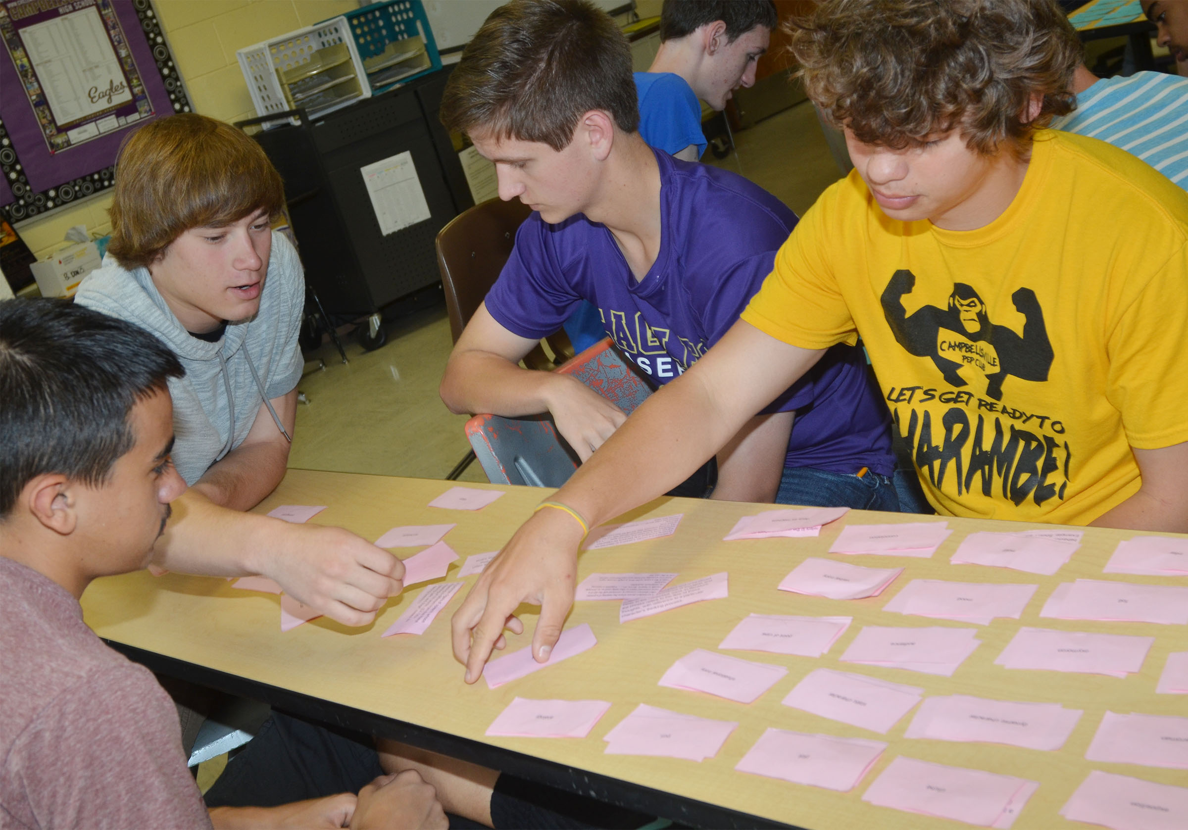 From left, CHS sophomores Glenn Lamer, Tristan Johnson, Myles Murrell and Treyce Mattingly work to pair their poetry terms with the definitions.