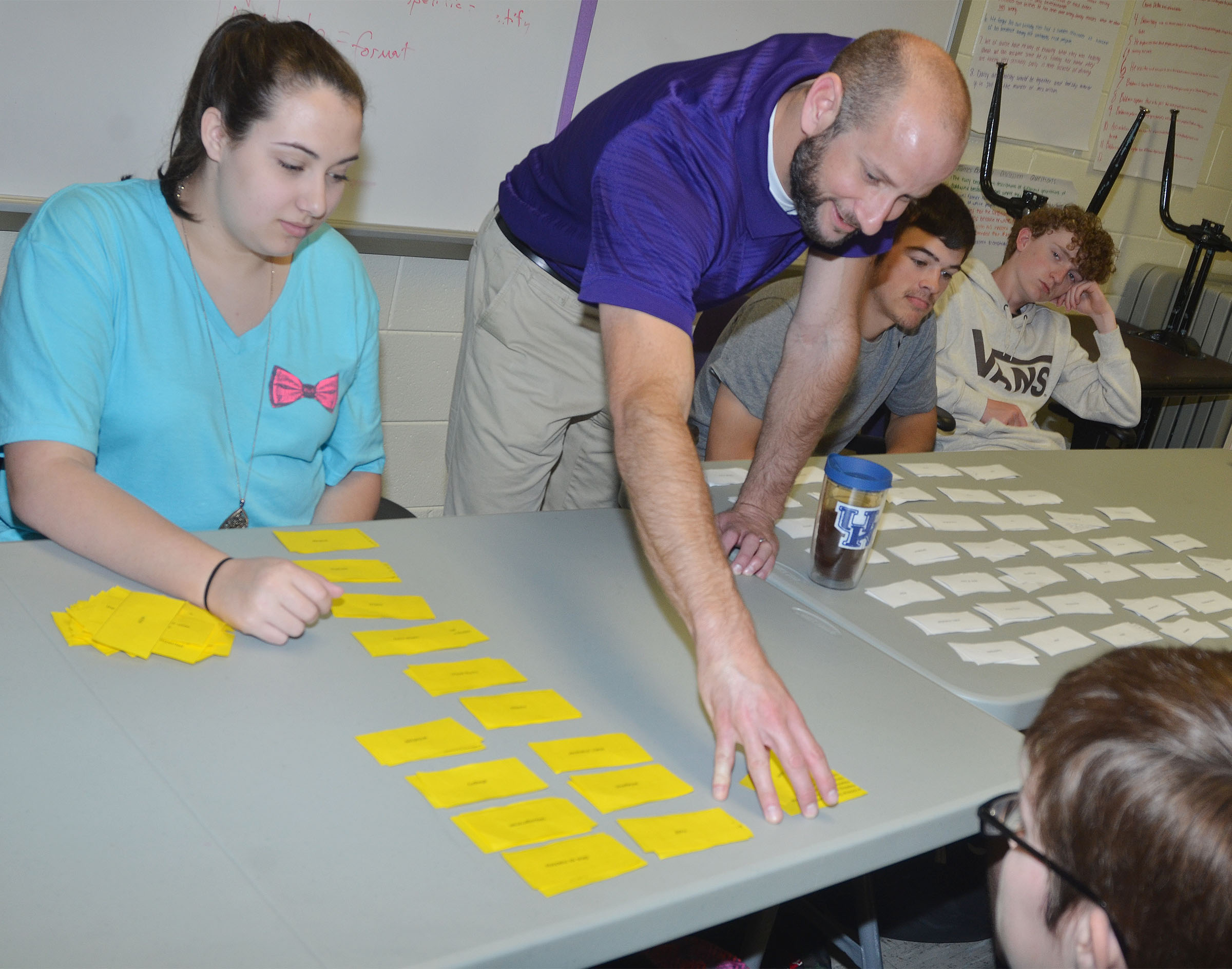 CHS AP English teacher Ben Davis checks sophomore Elizabeth Sullivan's groups paired poetry terms and definitions.