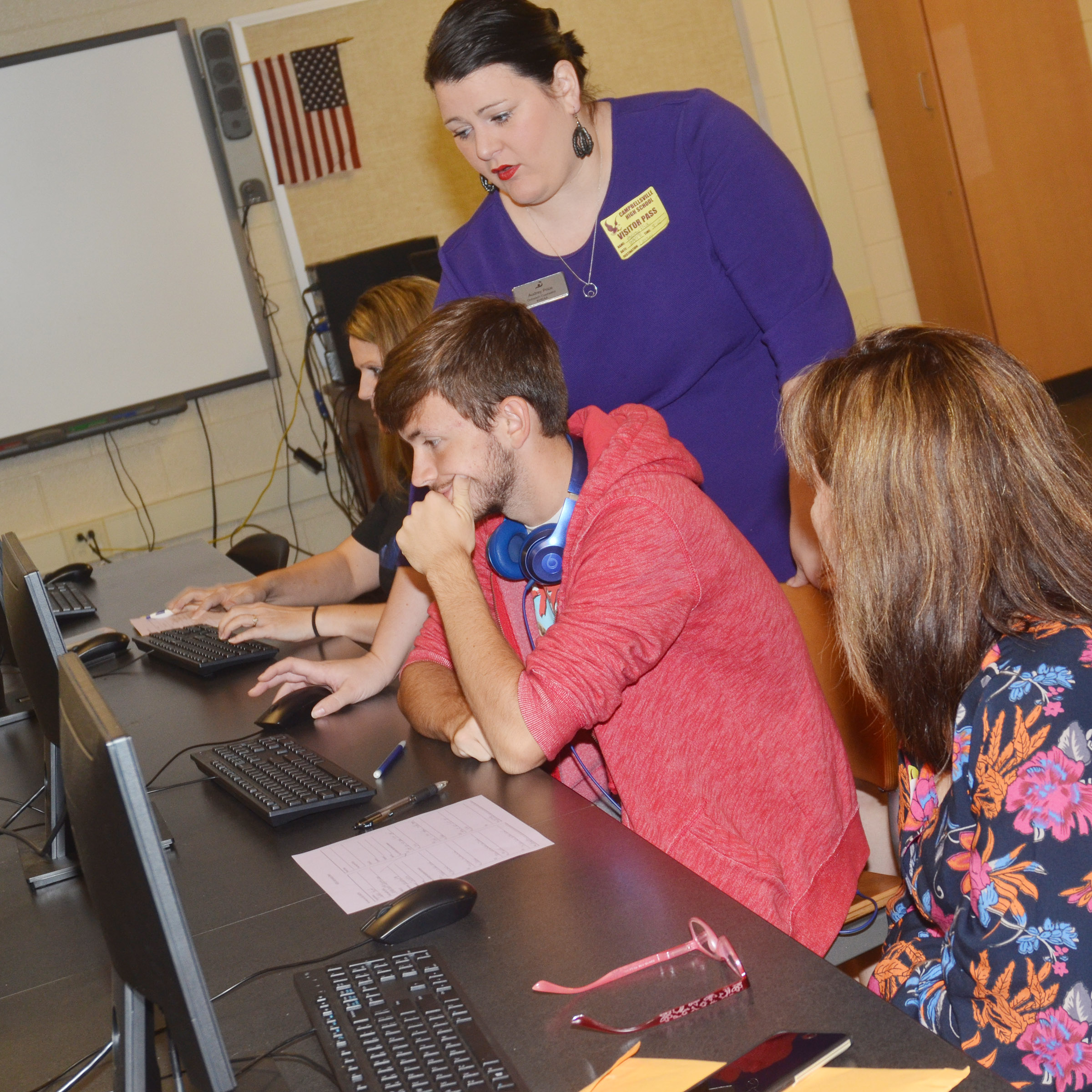 KHEAA representative Audrey Price helps senior Jackson Hunt and his mother Veronica complete their FAFSA.