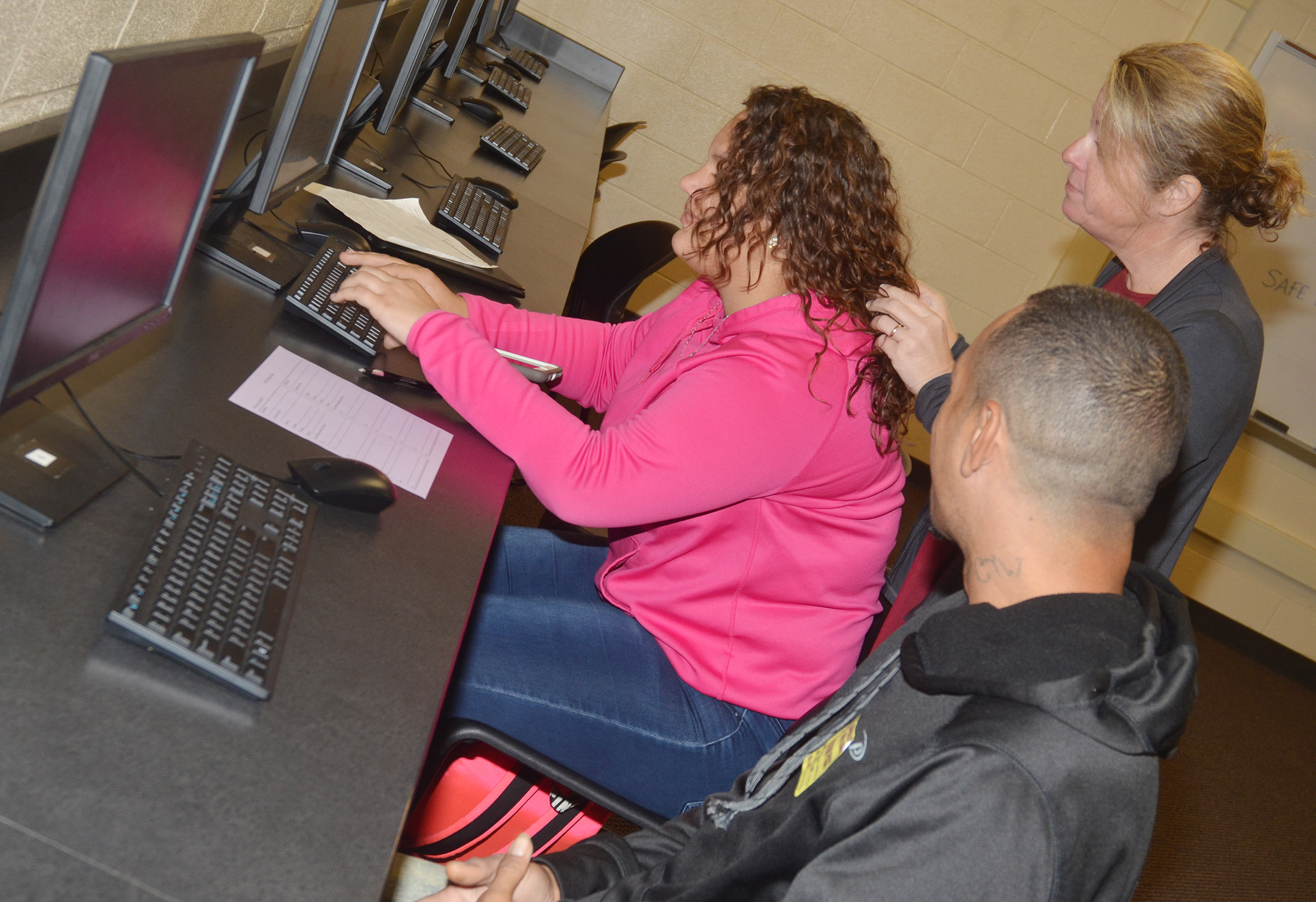 CHS College and Career Readiness Counselor Dee Doss helps CHS senior Jayden Bridgewater complete her FAFSA.
