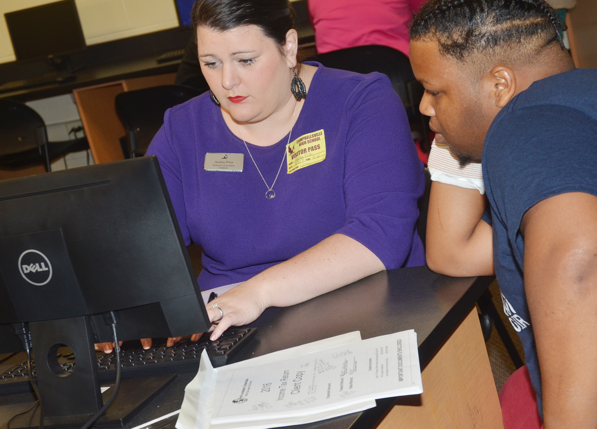 KHEAA representative Audrey Price helps CHS senior Darius Wright complete his FAFSA.