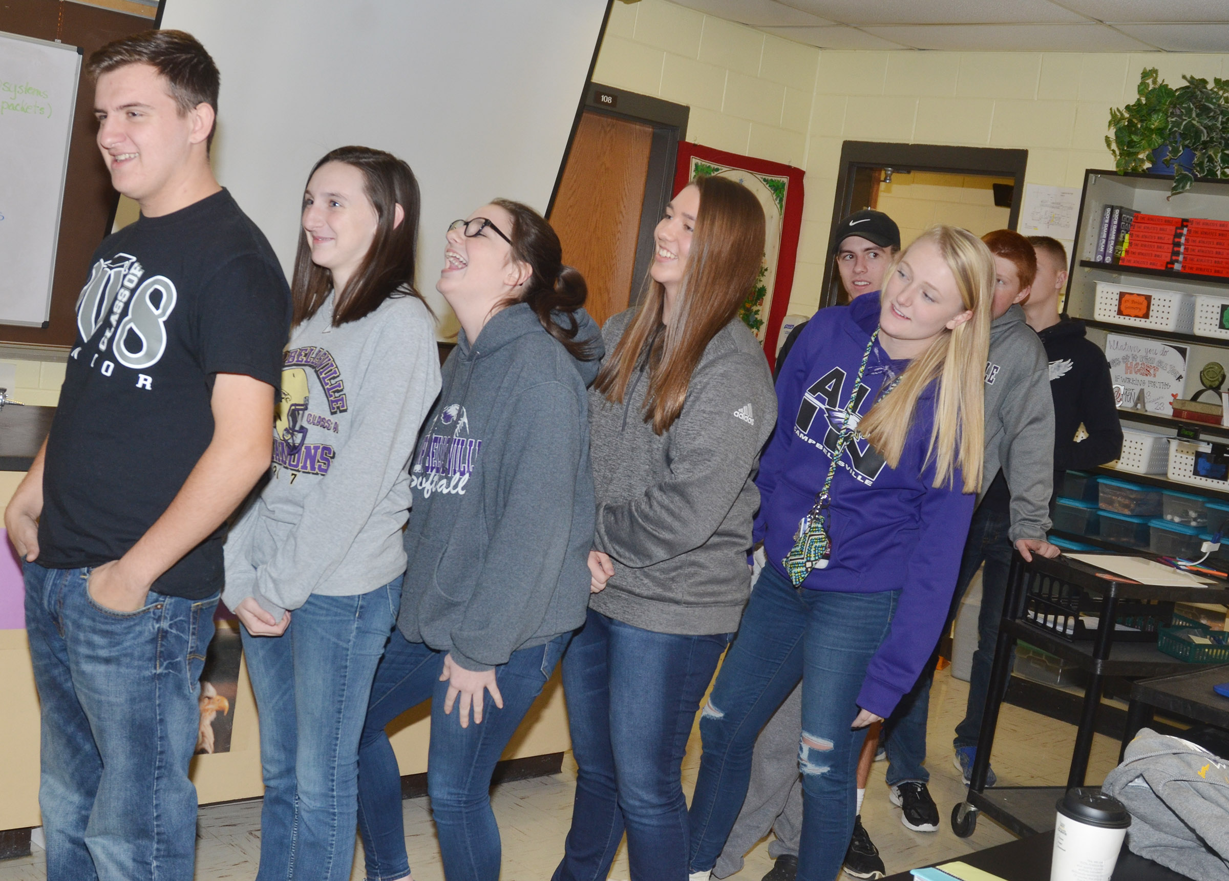 "CHS FCA members play an icebreaker game in which students form a line and ""write"" a symbol on each other's backs. The person at the front of the line tries to guess the symbol."