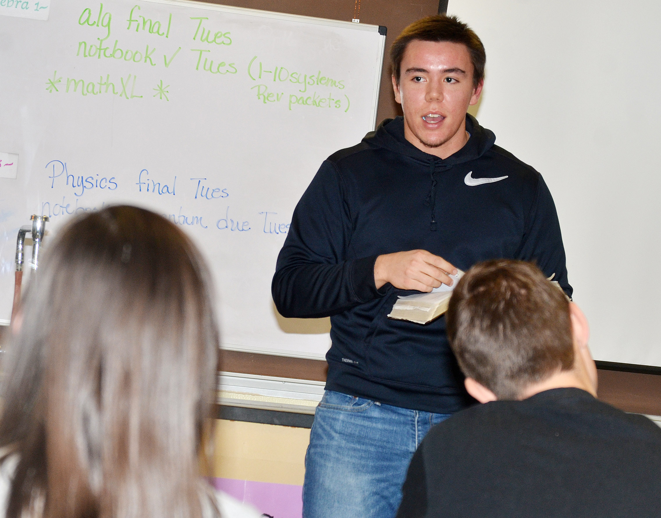 Campbellsville University senior Jordan Reed talks to CHS FCA members about keeping Christ in Christmas.