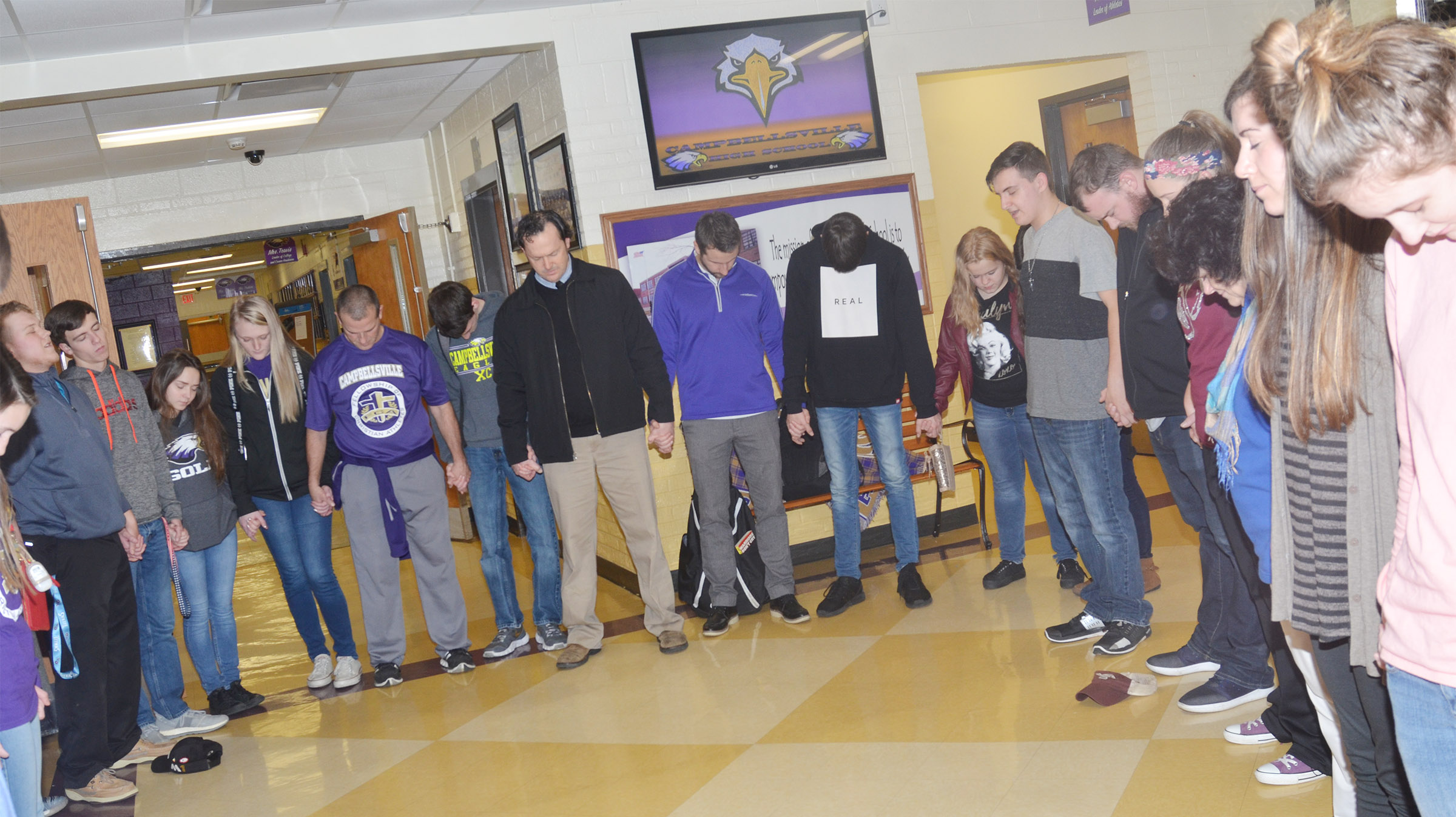 CHS FCA members hold hands as they pray together.