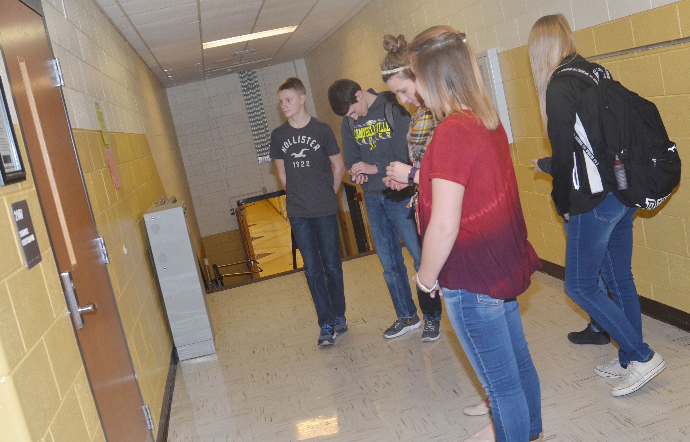 CHS students pray at their classrooms.