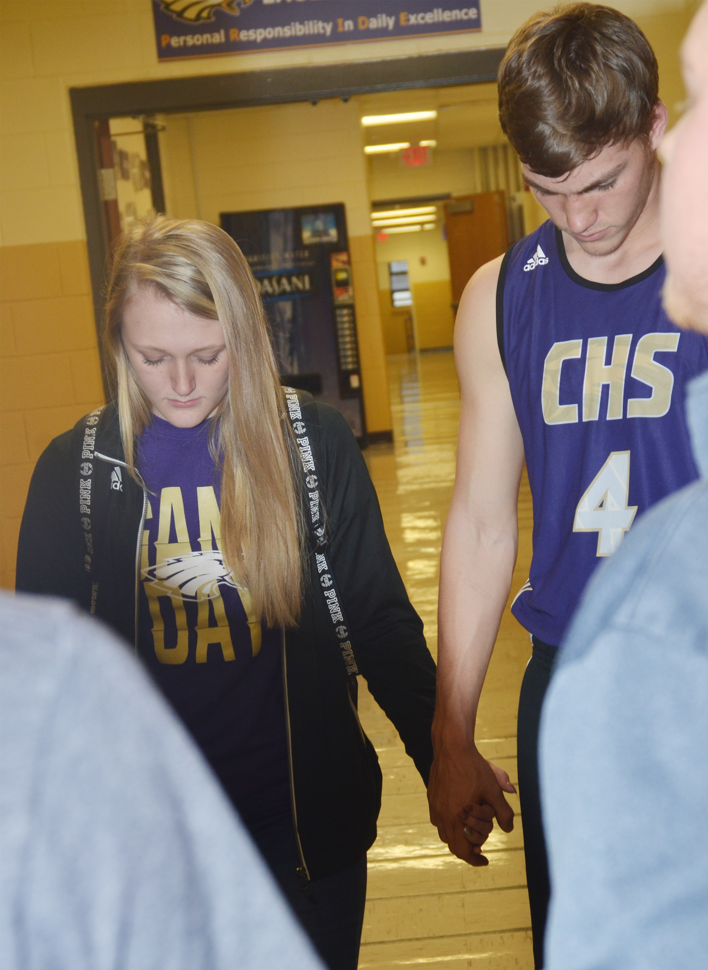 CHS sophomore Abbie Dicken, at left, and senior Zack Bottoms pray.