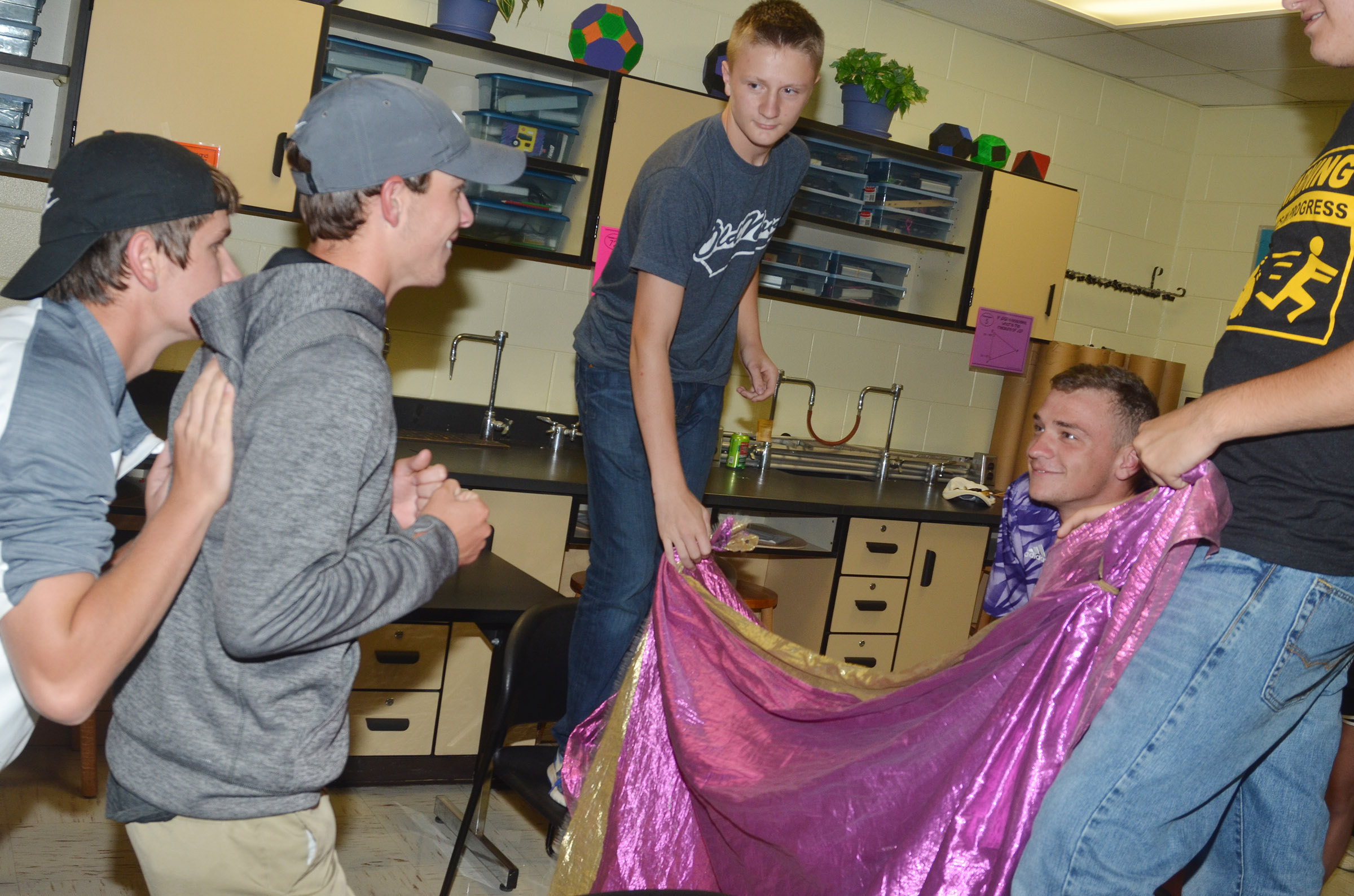 CHS juniors Myles Murrell and Layton Hord, at left, play the behind the curtain game with senior Connor Wilson.