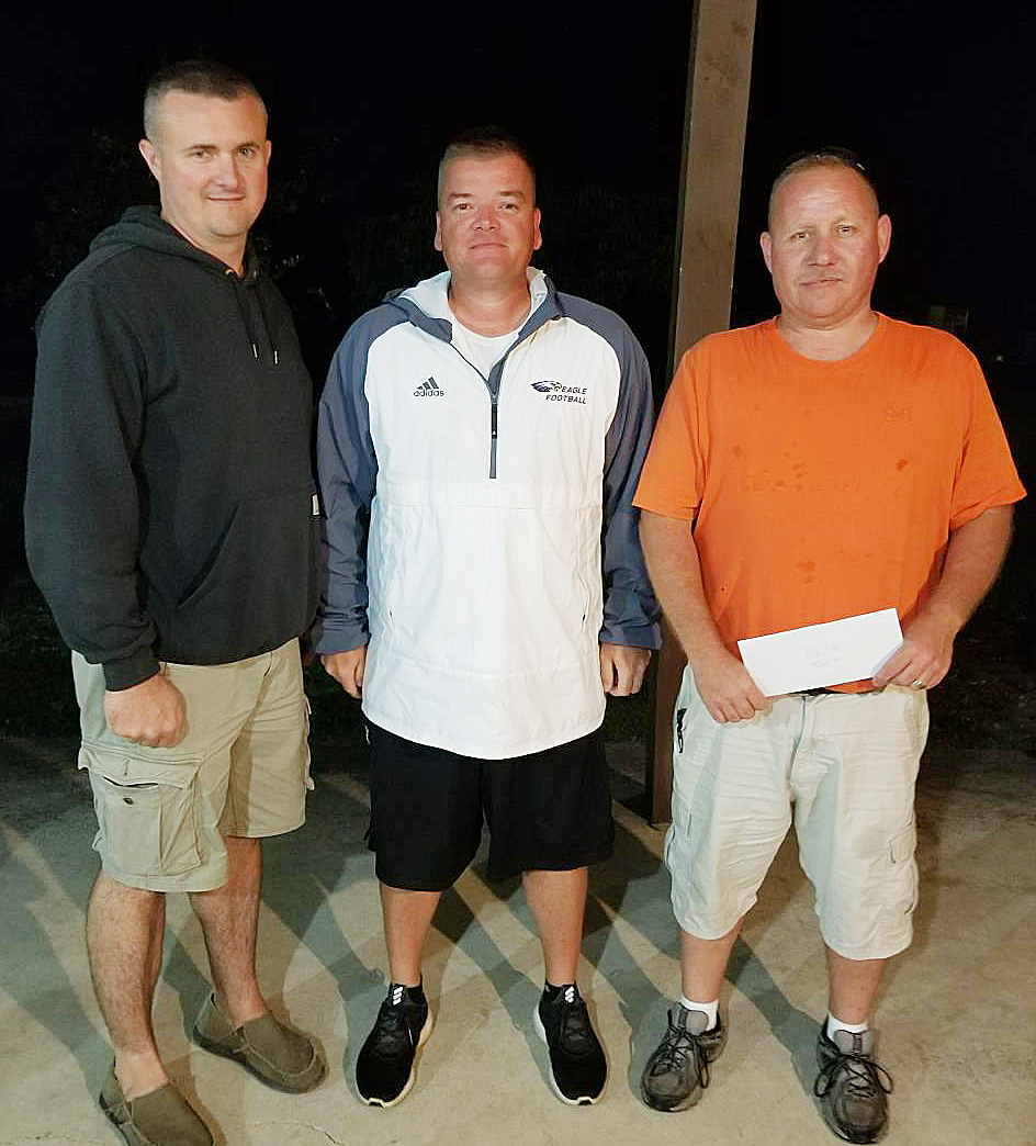 Delayne Smothers, at right, and Joey Allen, at left, won first place in the first CHS football bass tournament on Friday, Aug. 4. The duo took home a $1,000 prize, along with $210 for catching the biggest fish. They are pictured with CHS head football coach Dale Estes.