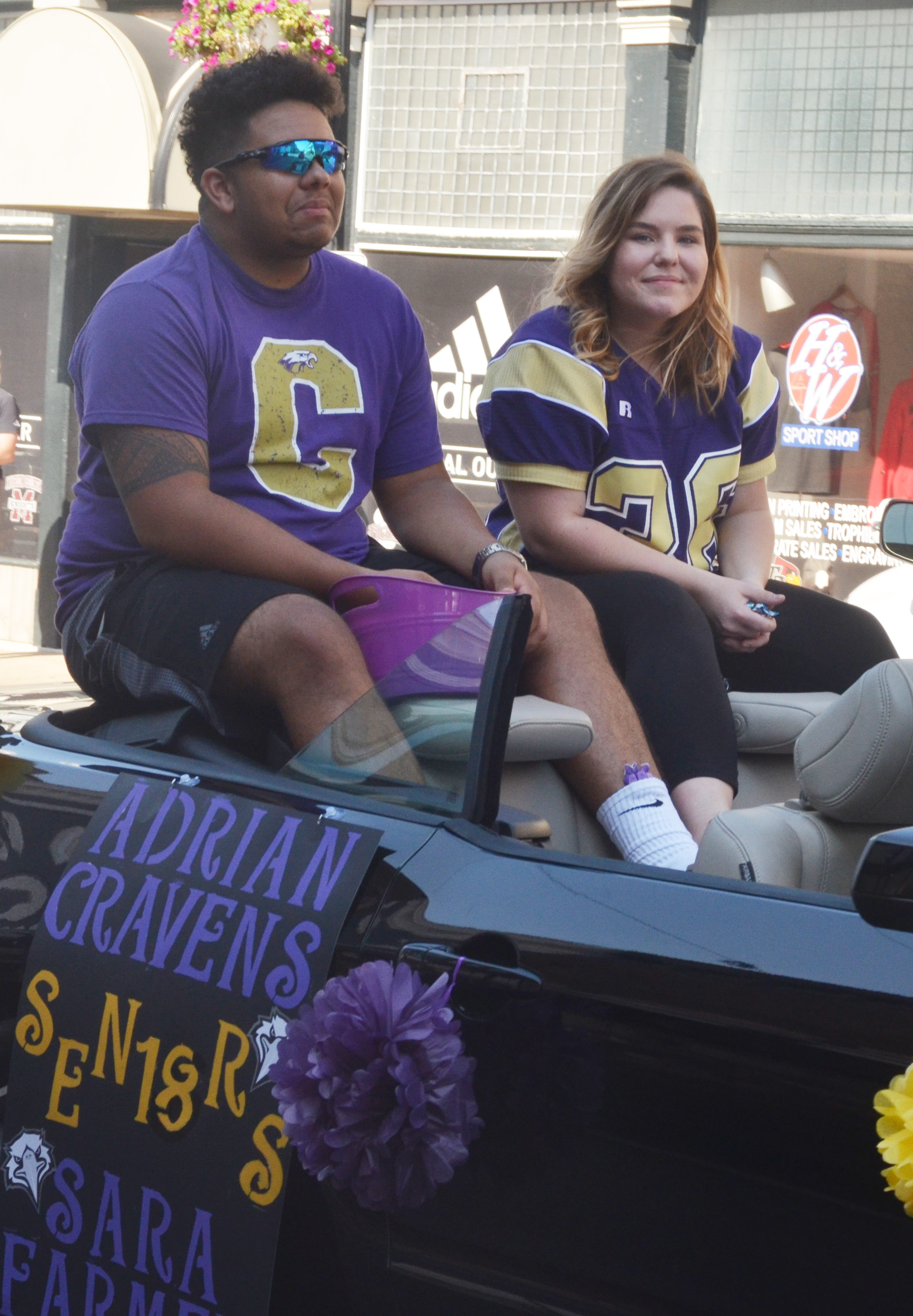 CHS senior homecoming candidates Adrian Cravens and Sara Farmer ride in the parade.